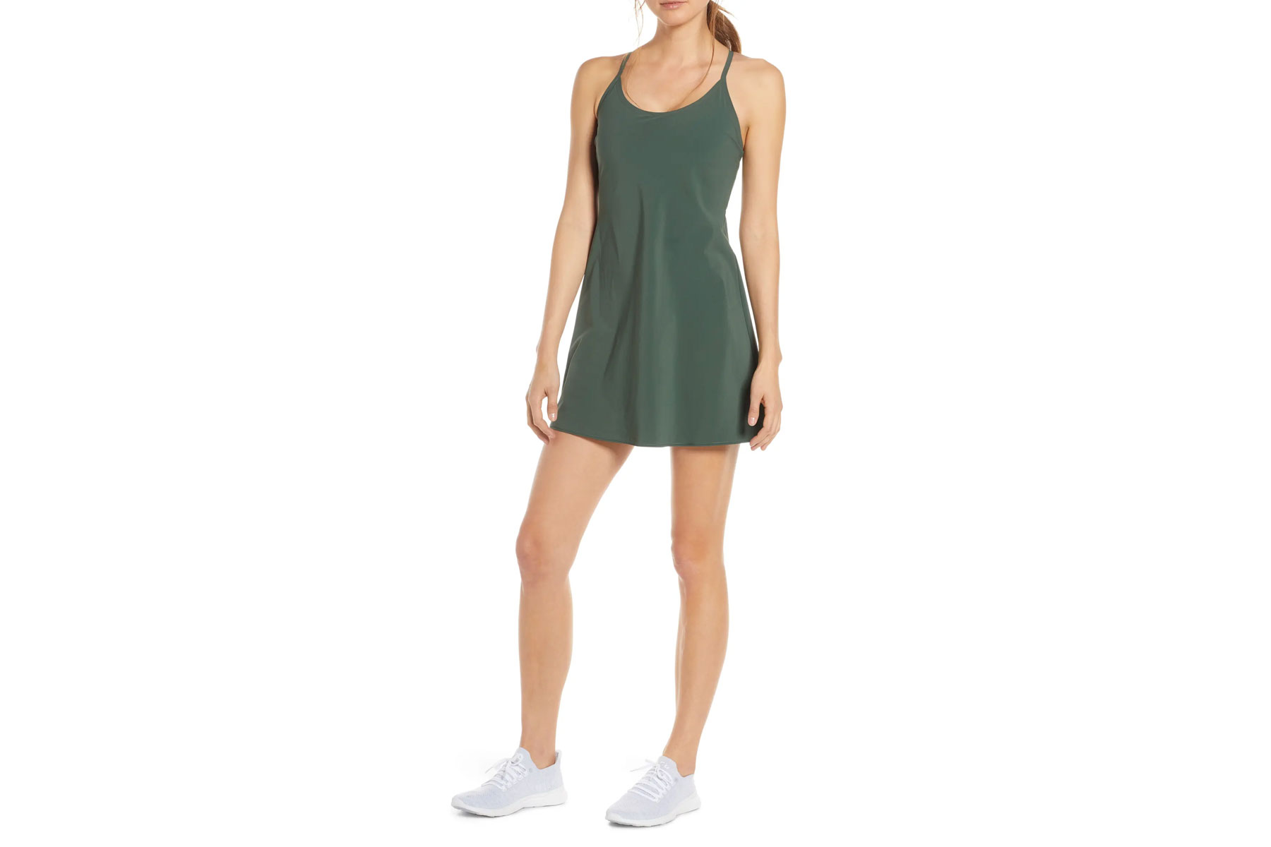 Woman wearing olive green exercise dress