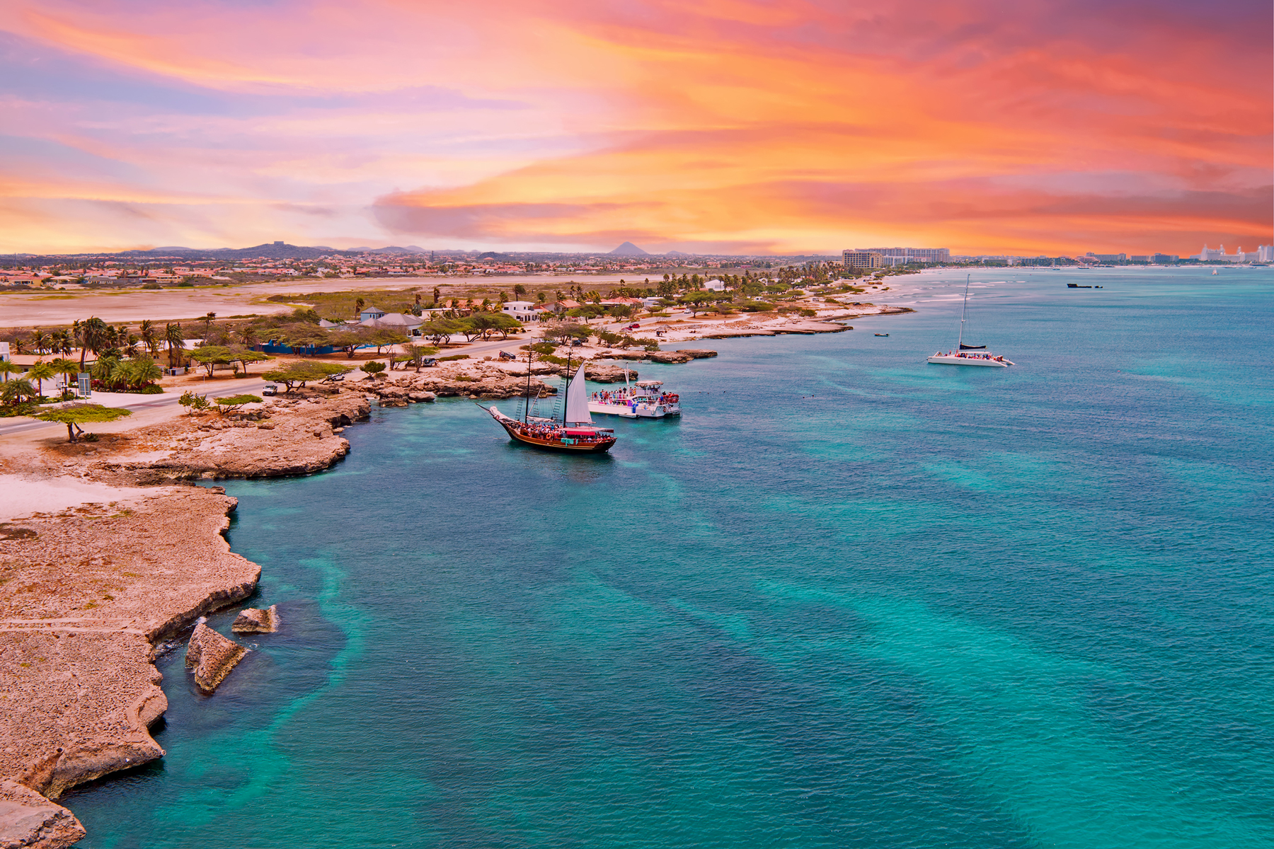 Aerial from Aruba island with Palm Beach in the Caribbean Sea at sunset