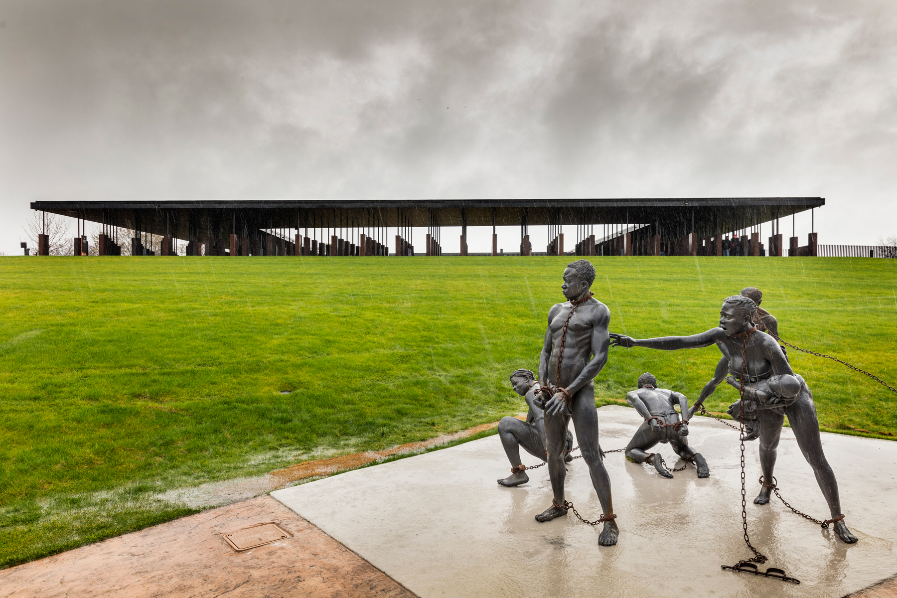 Kwame Akoto-Bamfo's 'Nkyinkim' sculpture, dedicated to the memory of the victims of the Transatlantic slave trade at the entrance of the National Memorial for Peace And Justice
