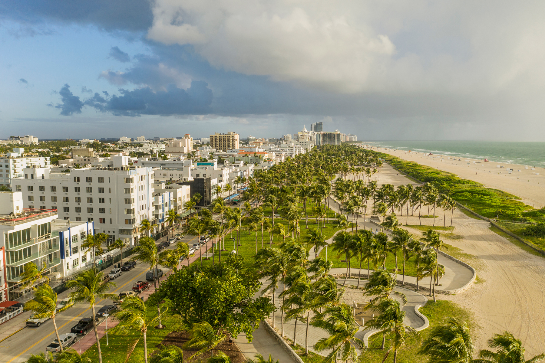Aerial view of the art deco buildings on Ocean Drive, the Lummus Park and the beach of South Beach.