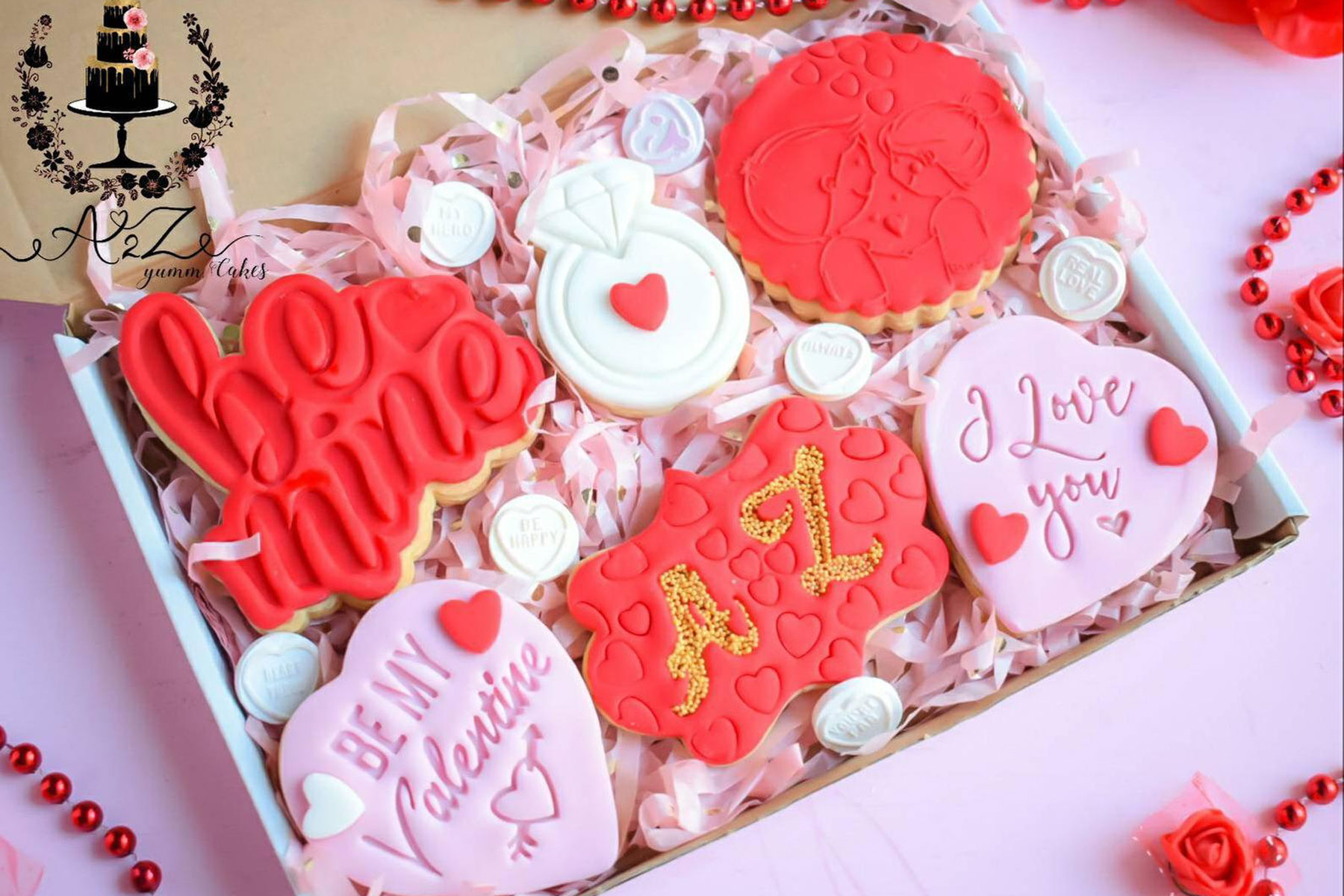 Various red and pink Valentine's Day themed cookies
