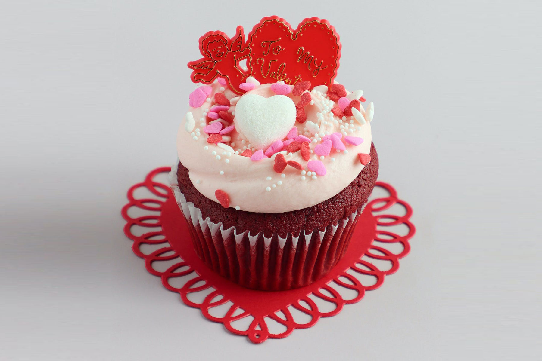 Red velvet cupcake with pink and red sprinkles