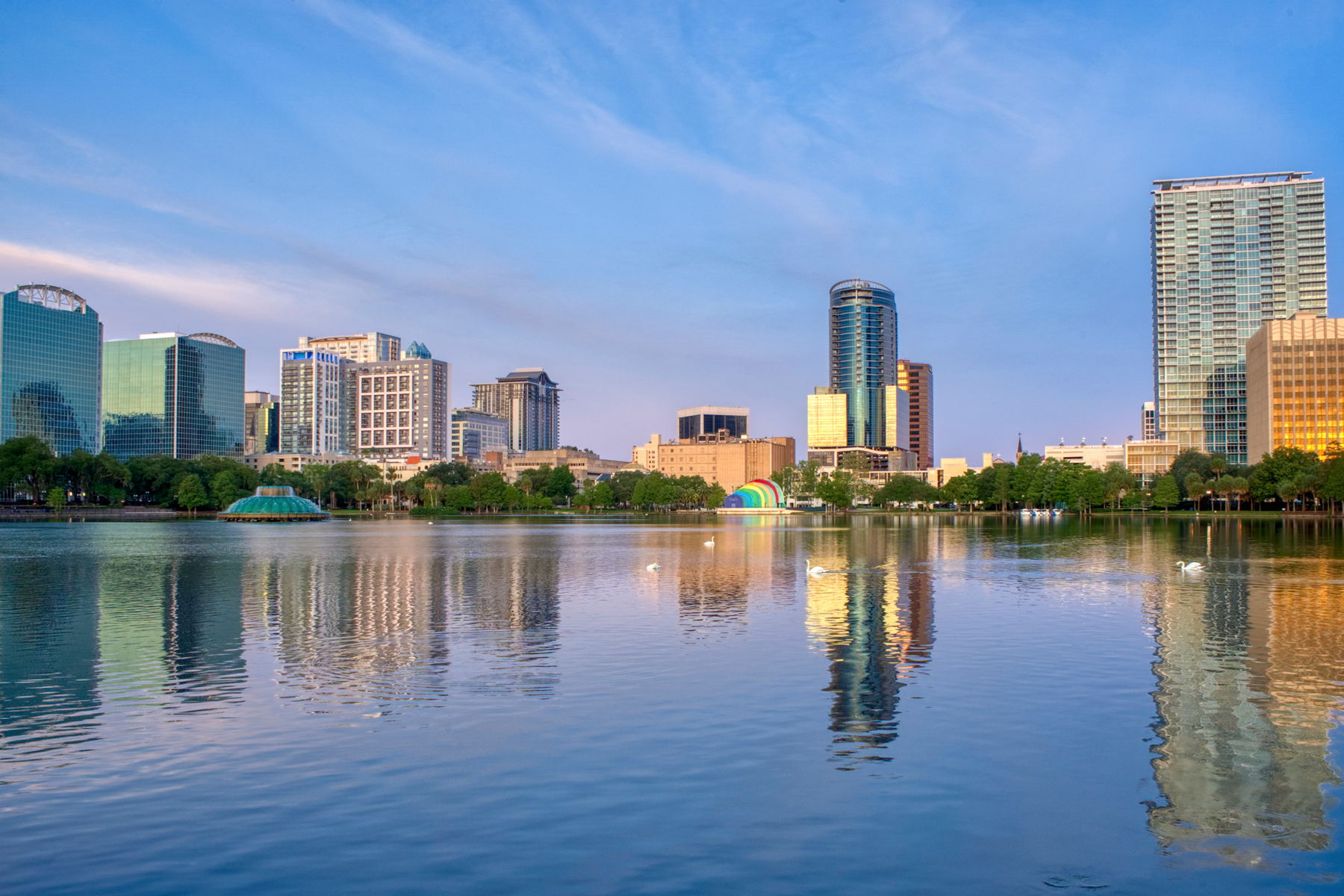 Vibrant Sunrise Over Lake Eola Park and the Orlando Skyline in Downtown Orlando. Florida