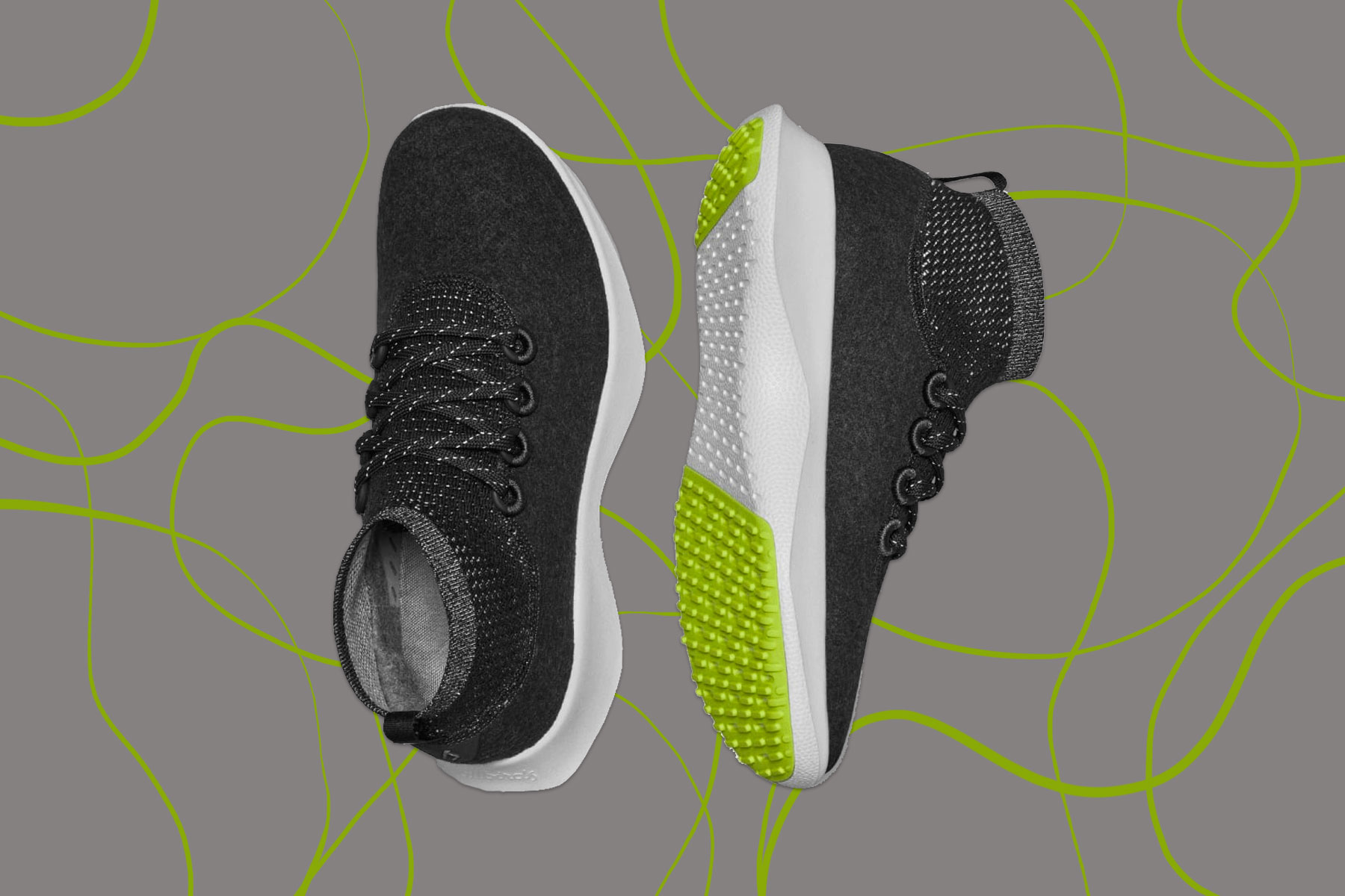 Black, white, and neon green running shoes