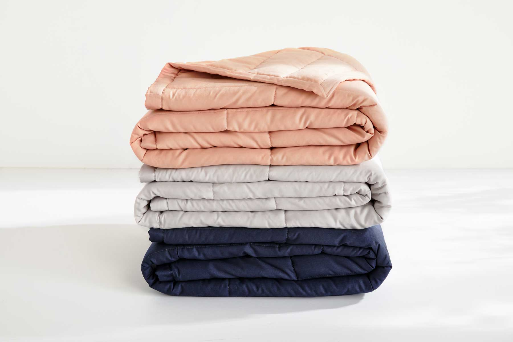 Three blankets stacked