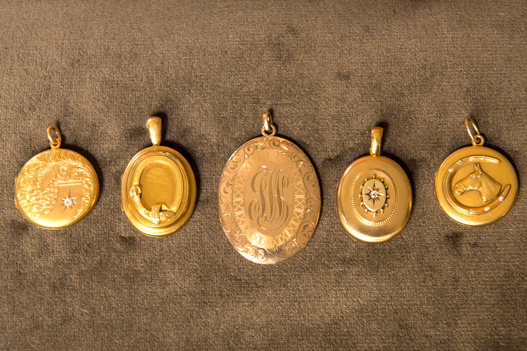 Gold lockets from Croghan's Jewel Box in Charleston