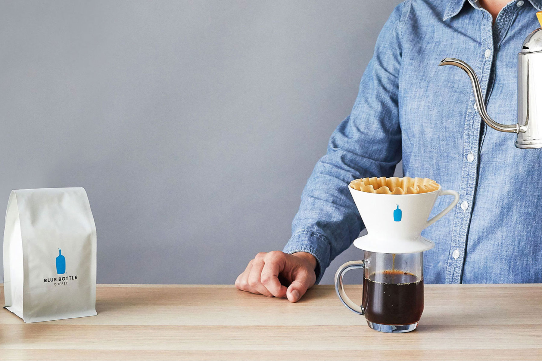 Pour over coffee with bag of blue bottle coffee