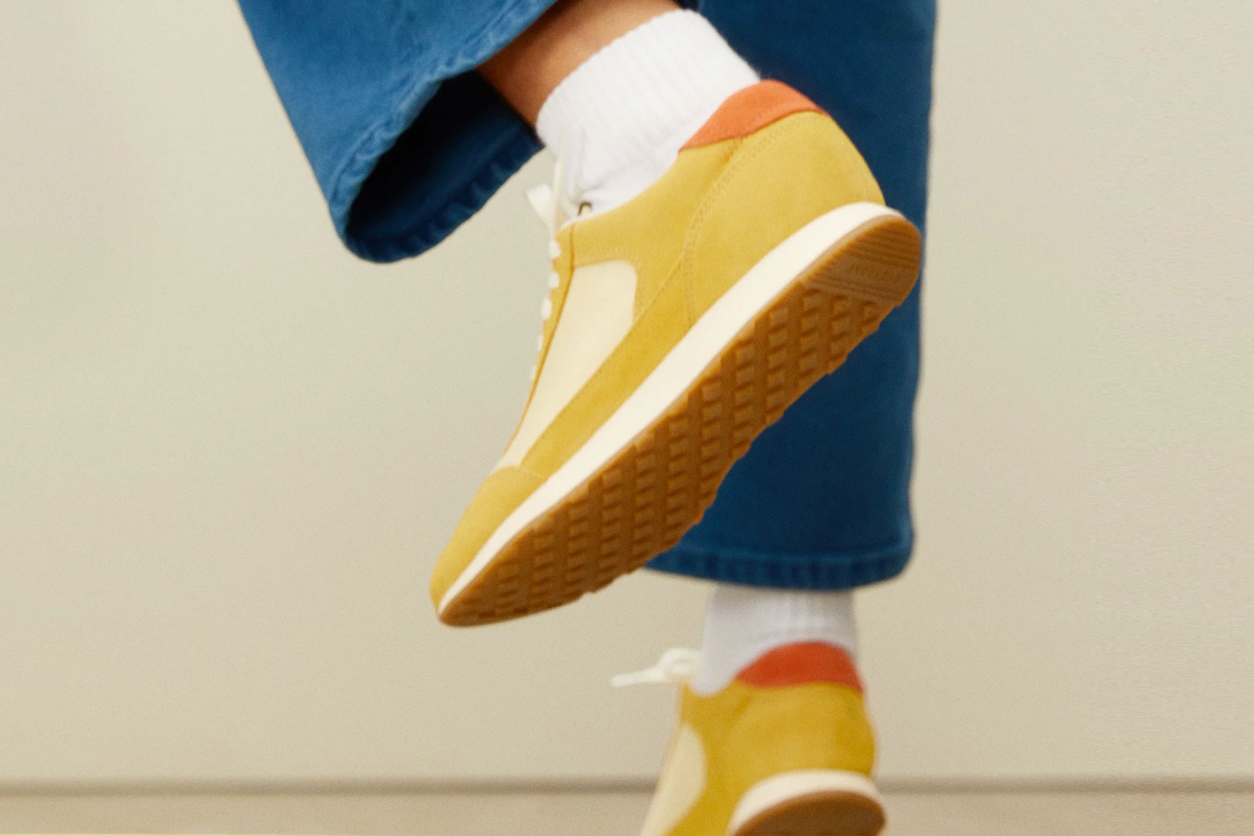 Close up of mustard yellow running shoe