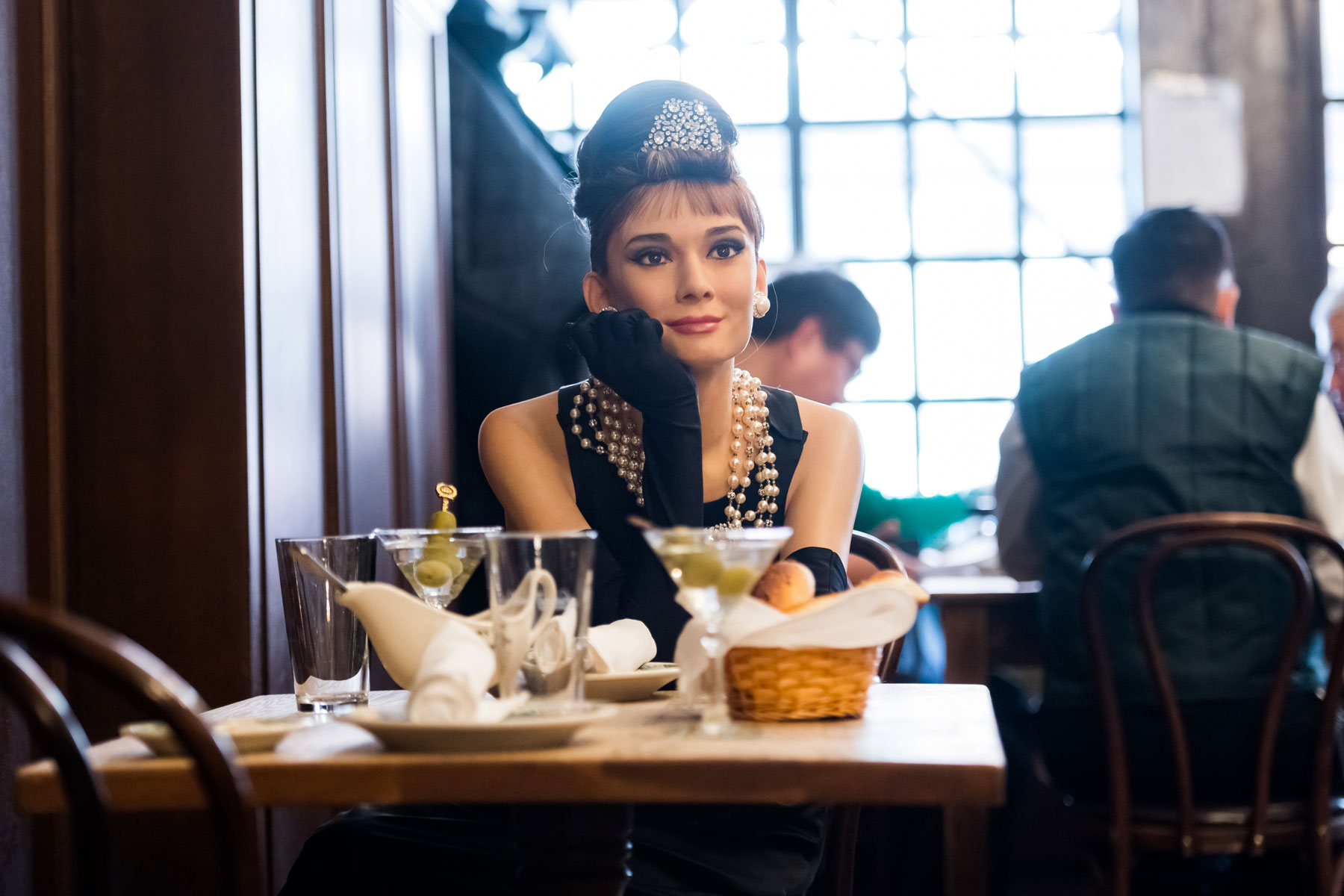 Madame Tussaud's Audrey Hepburn wax figure at a dining table
