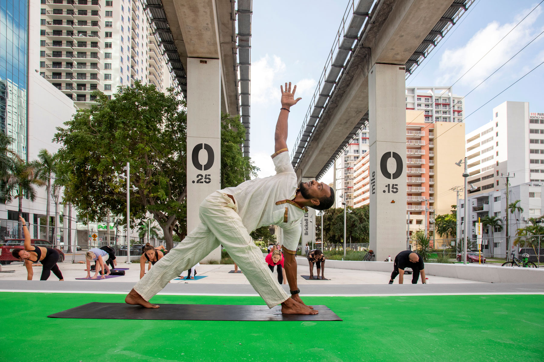 person doing yoga at The Underline Park