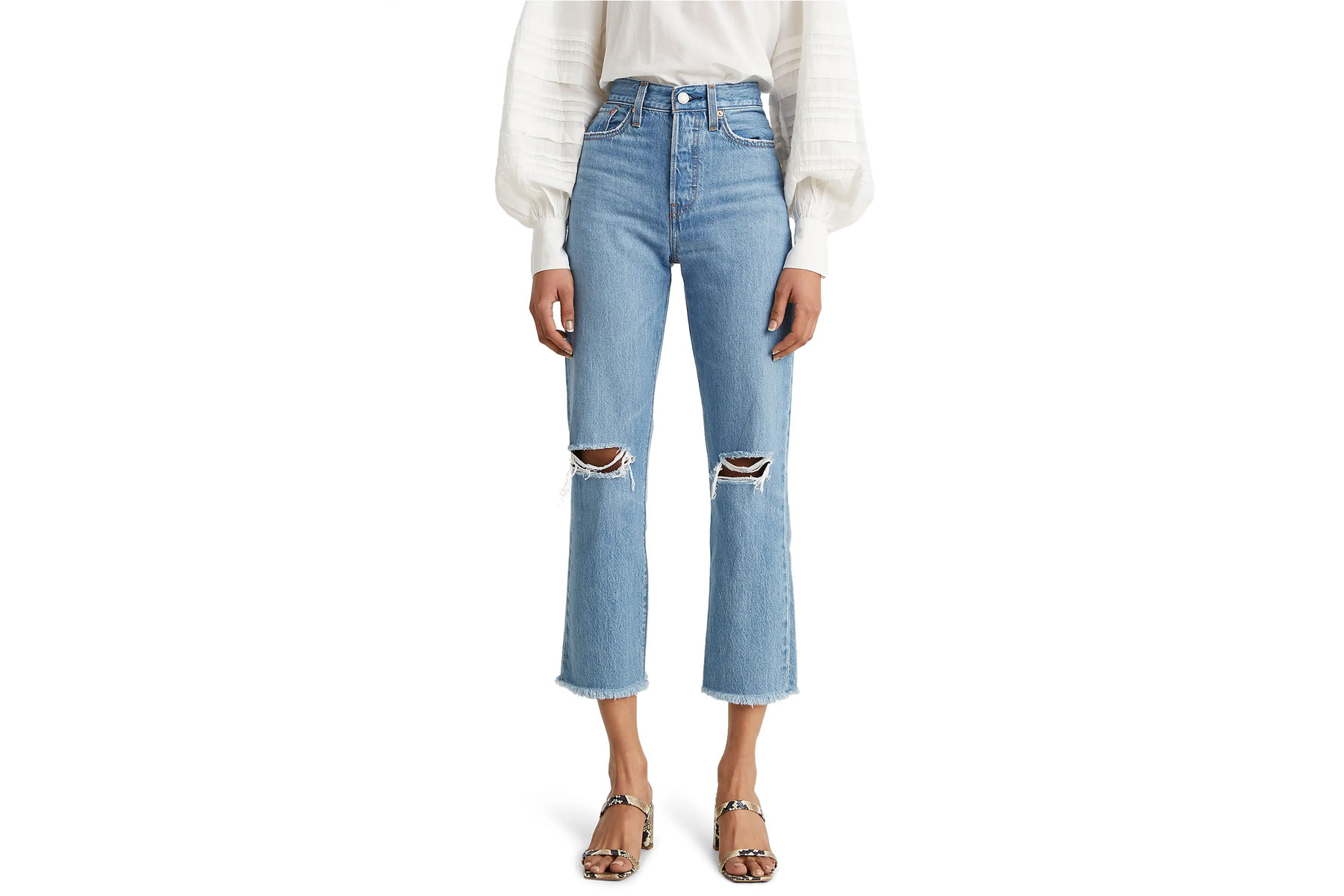 Woman wearing cropped ripped straight leg jeans