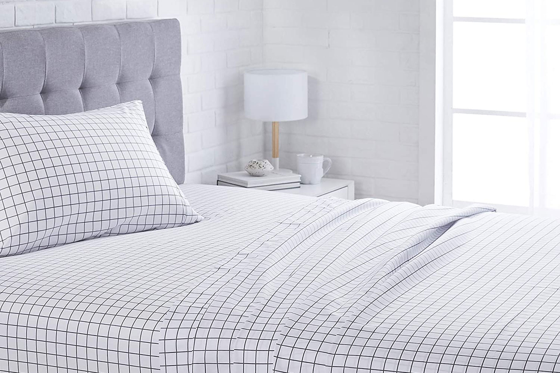 Black and white grid sheets on bed