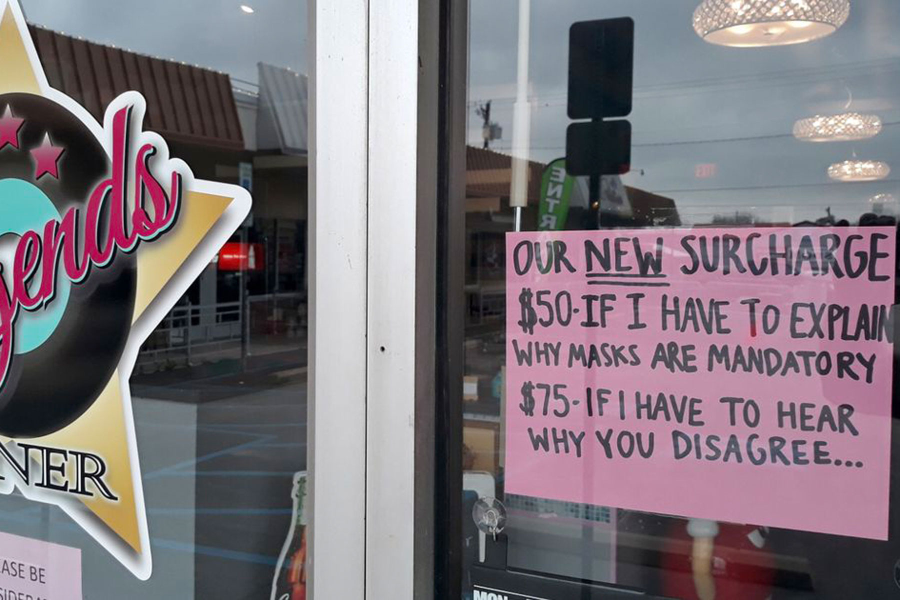 a new sign on the door at legends diner in texas stating people who refuse to wear masks must pay for admittance