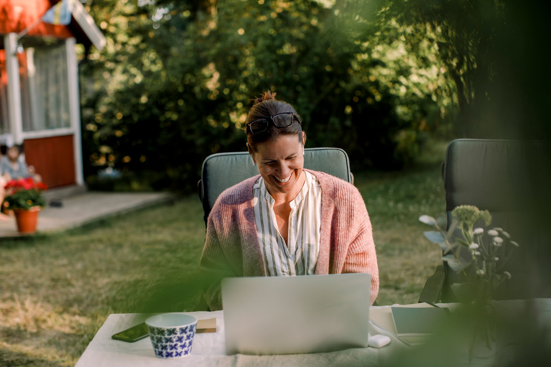woman using a laptop outdoors