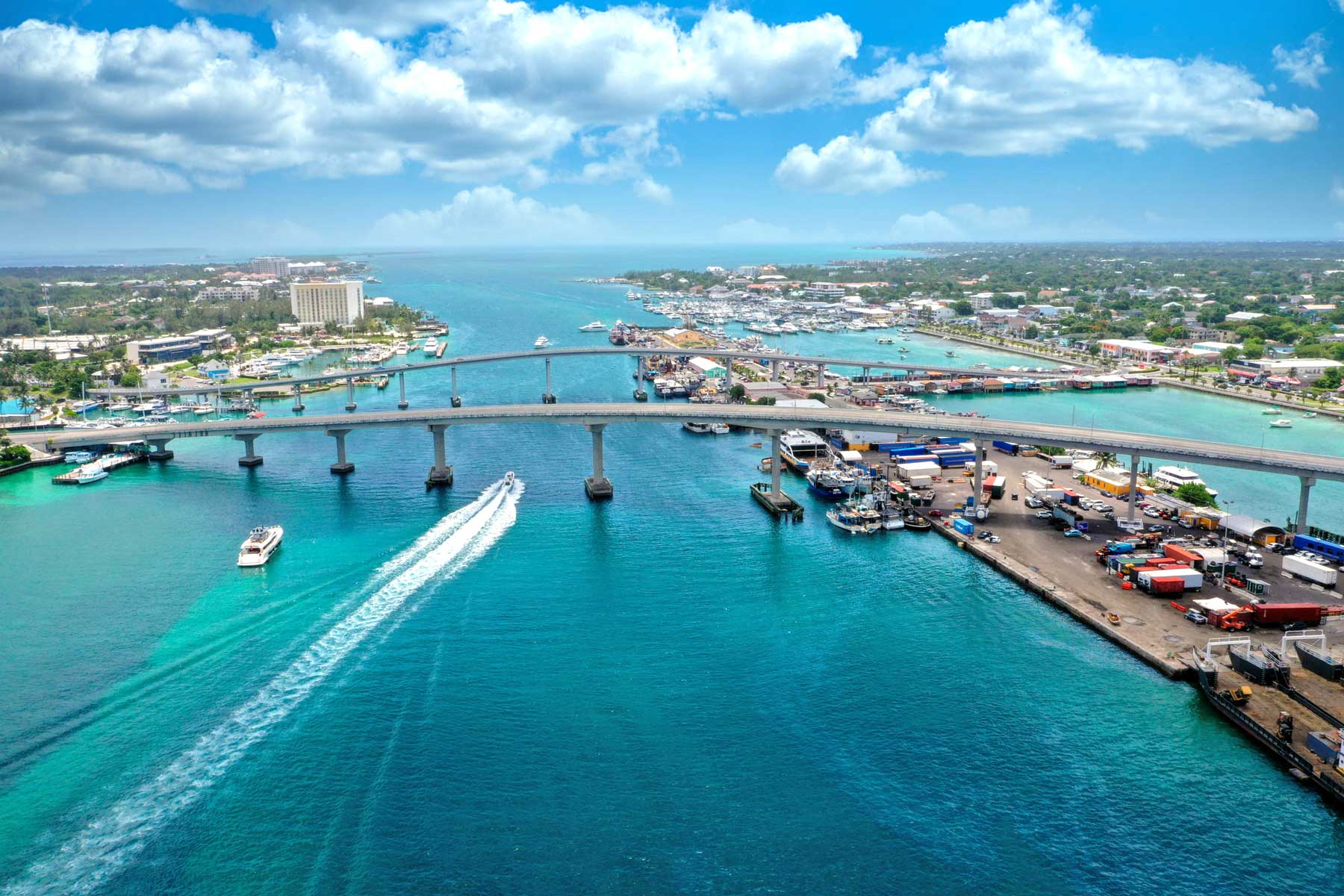 Bridges over blue water with boats in Nassau, Bahamas