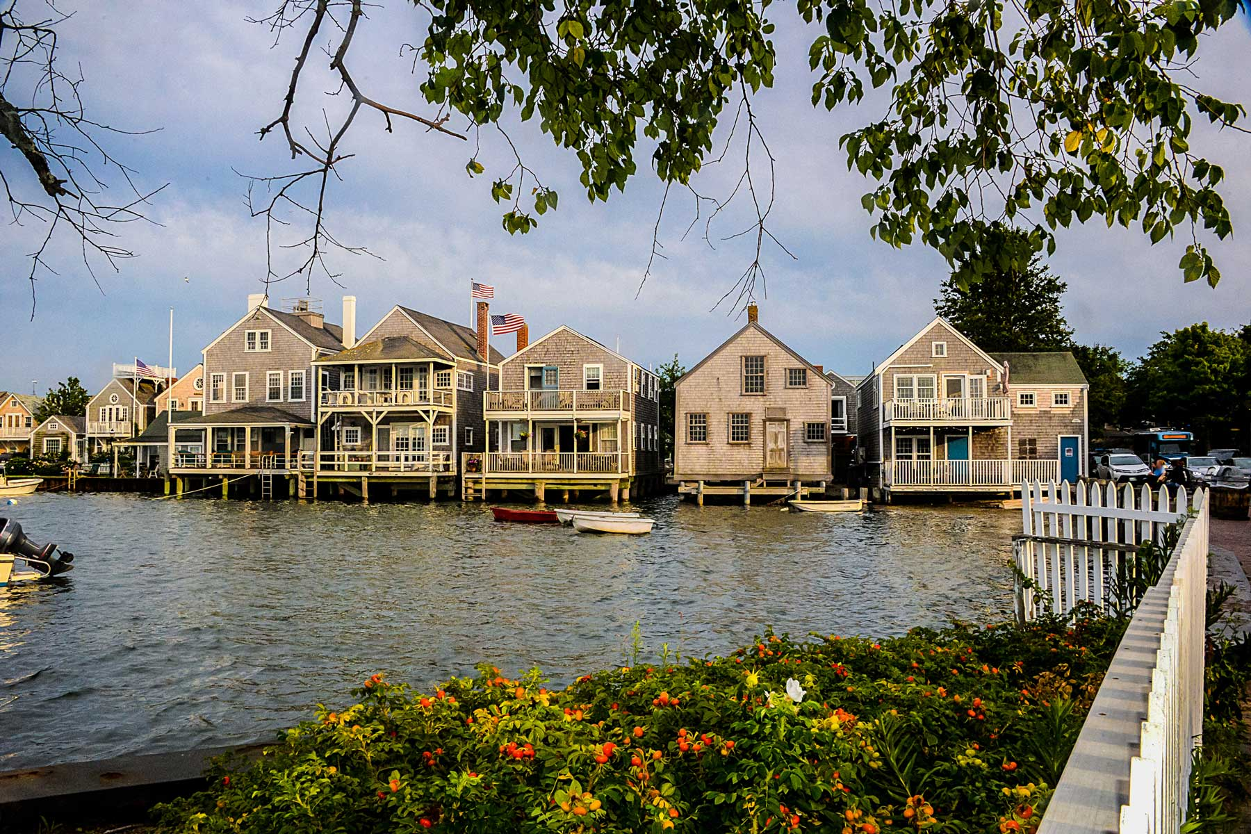 A view of homes and boats on the water of Nantucket Island