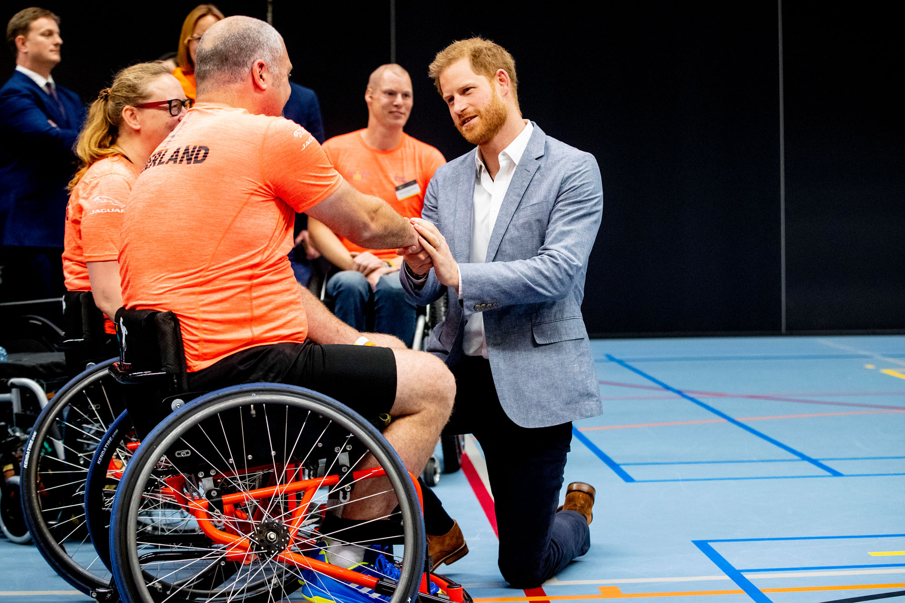 Prince Harry greets athletes during the launch of the Invictus Games