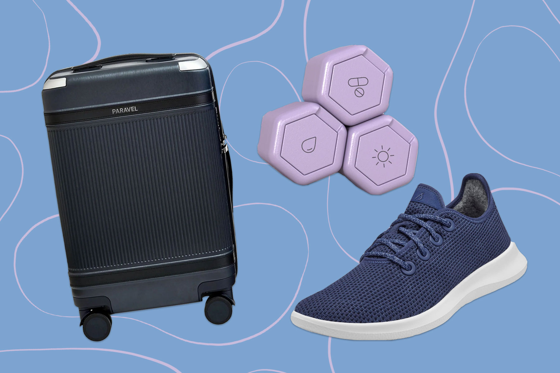 Allbirds navy sneakers, purple toiletry containers, navy suitcase