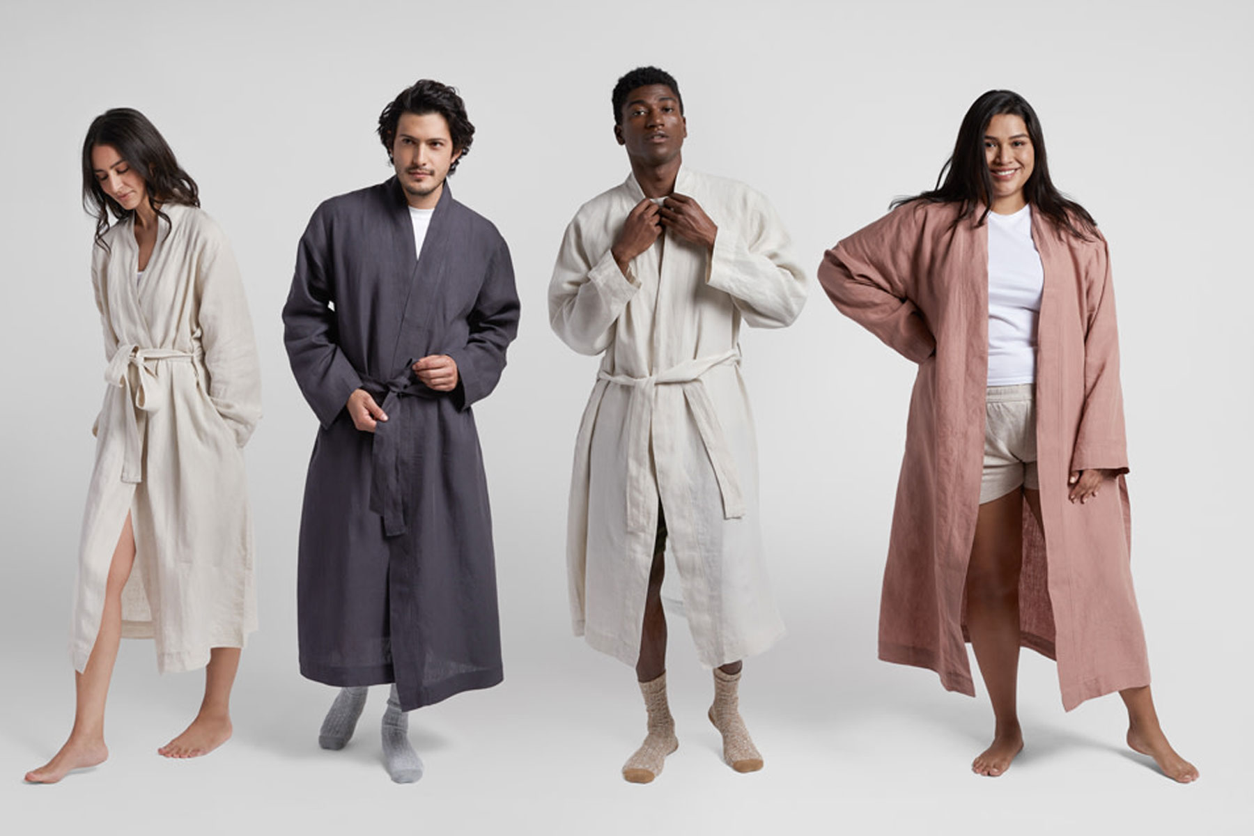 Men and women wearing linen bathrobes