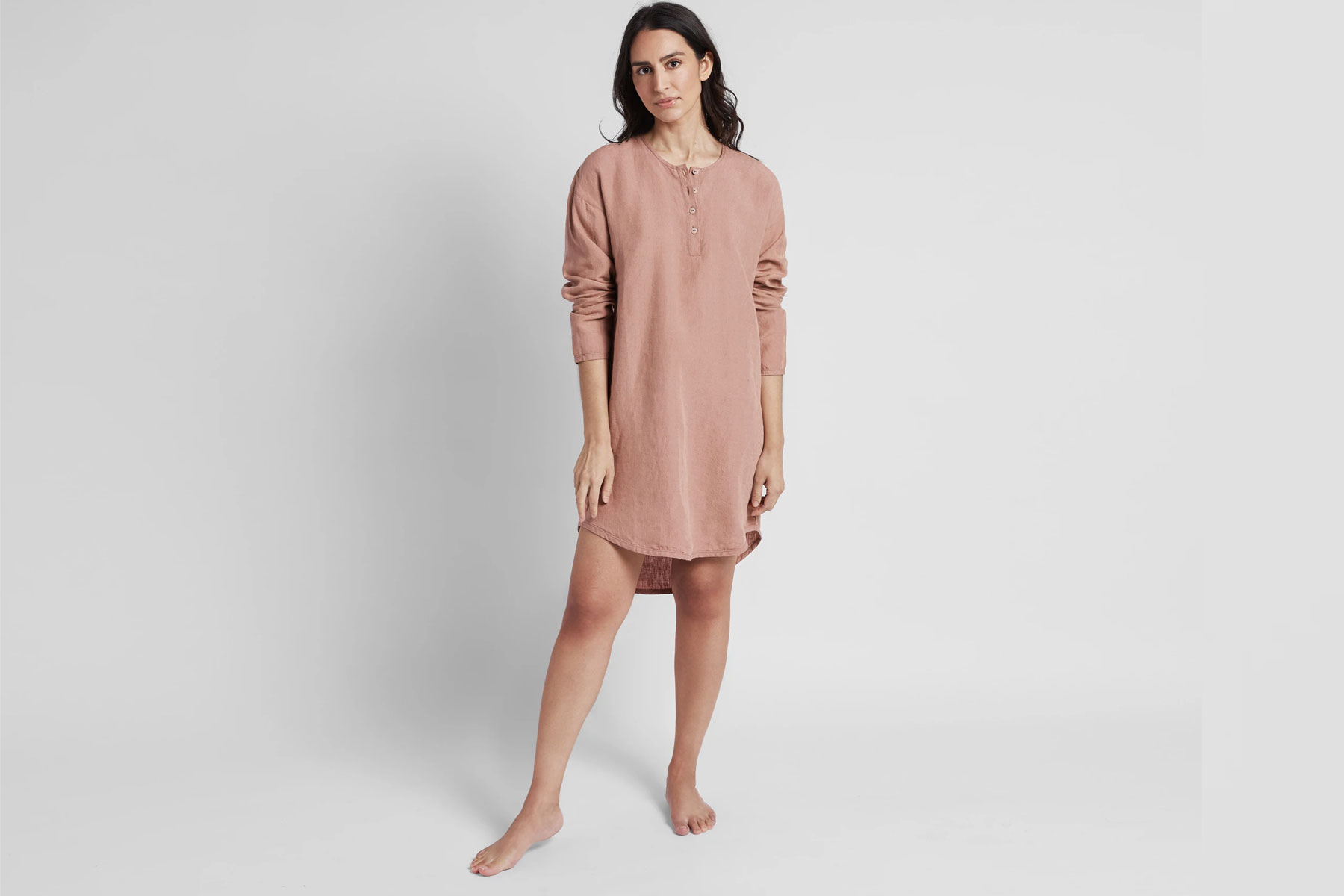 Woman wearing pink linen sleep shirt