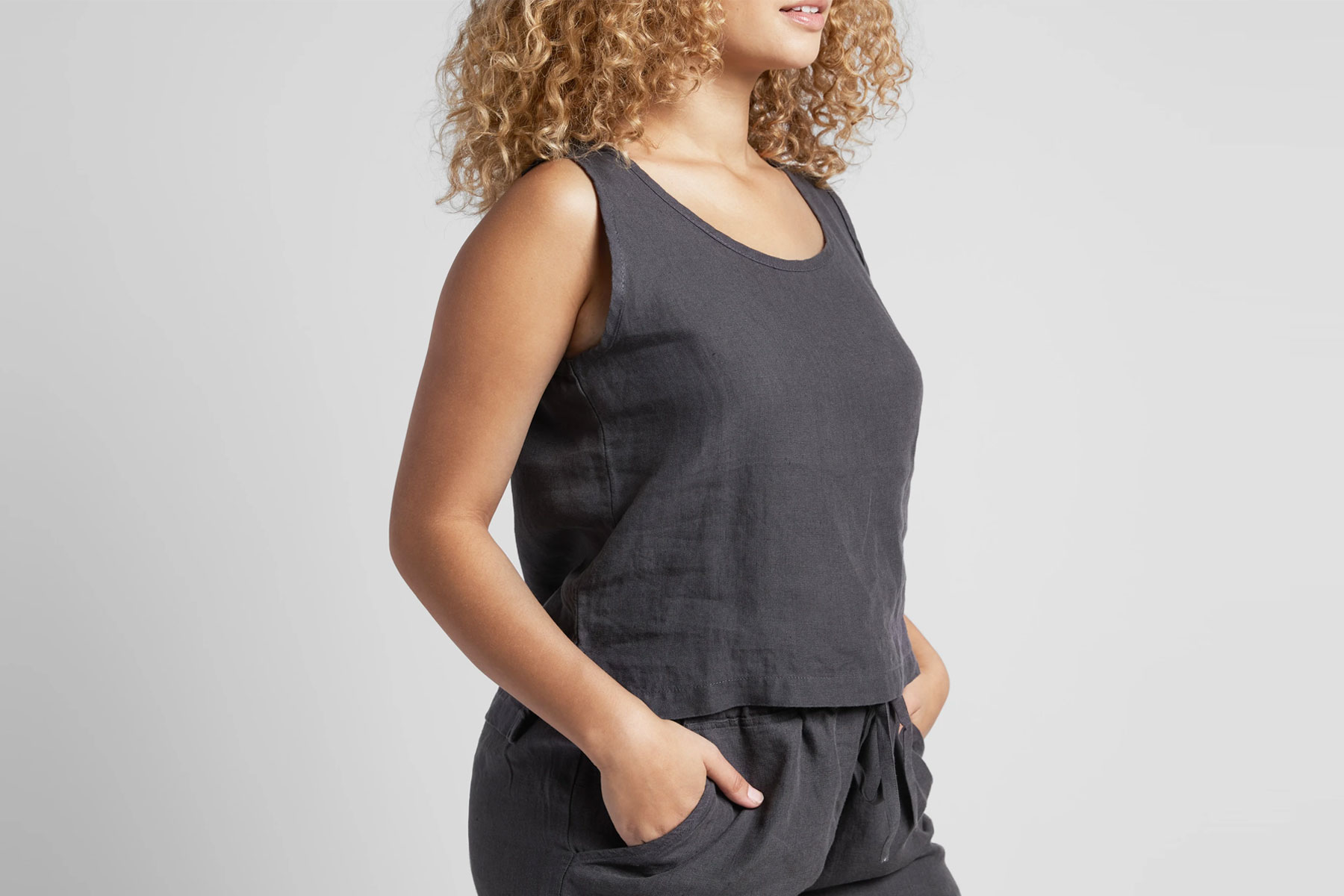 Woman wearing black linen tank