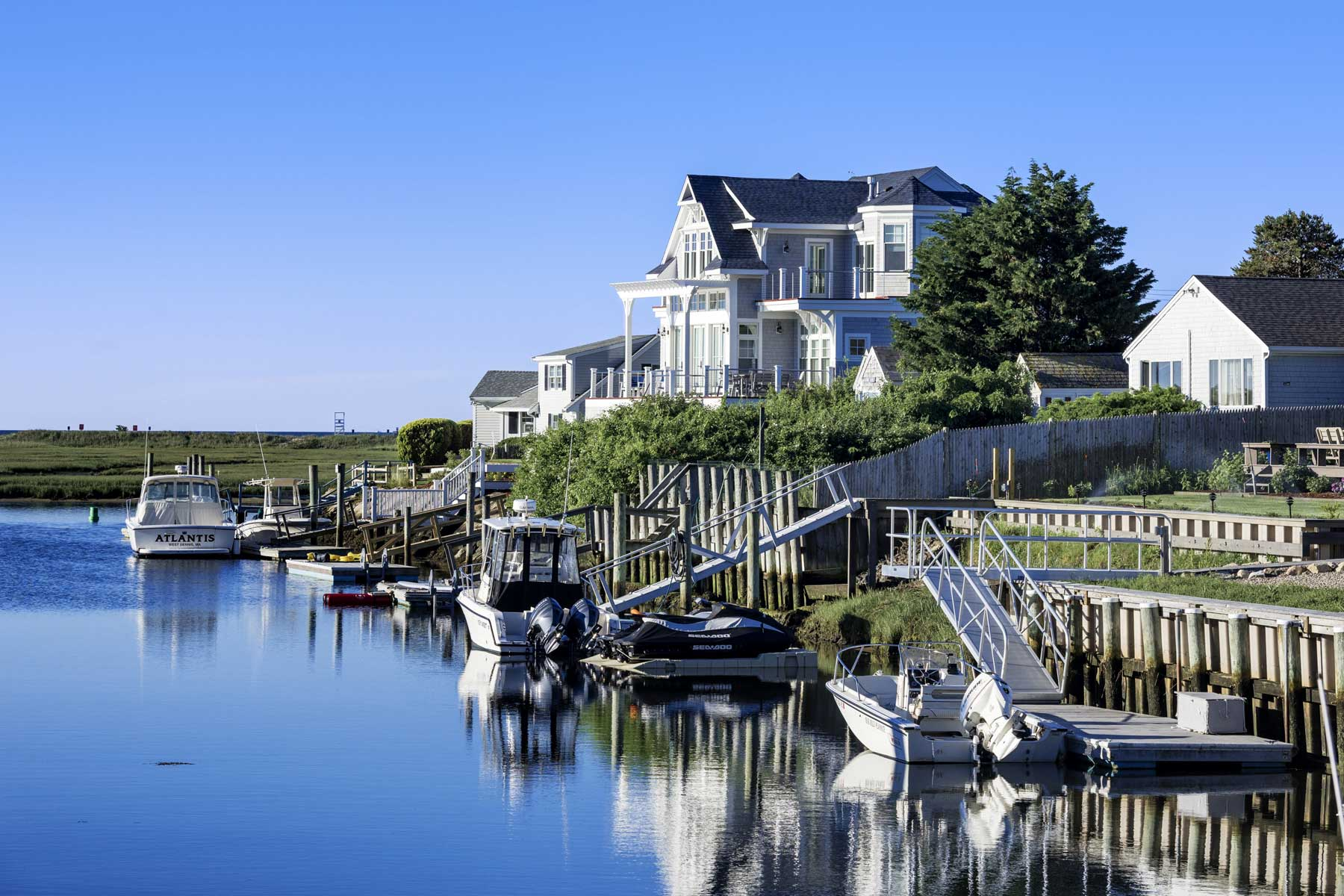 Charming canal waterfront house at West Dennis on Cape Cod in Massachusetts.