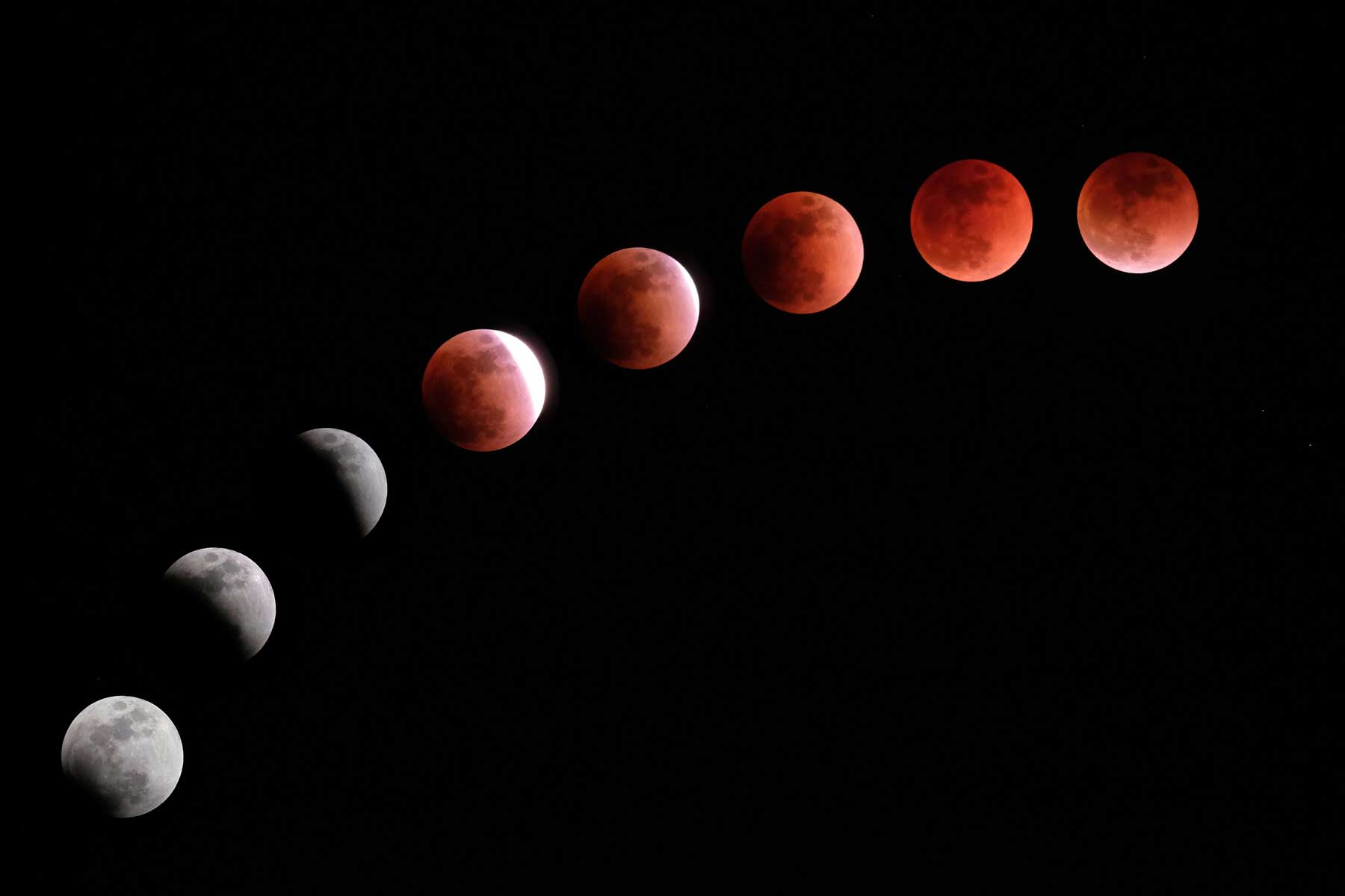 """This composite image created on January 31, 2018 shows the moon during a lunar eclipse referred to as the """"super blue blood moon"""" in Tokyo."""