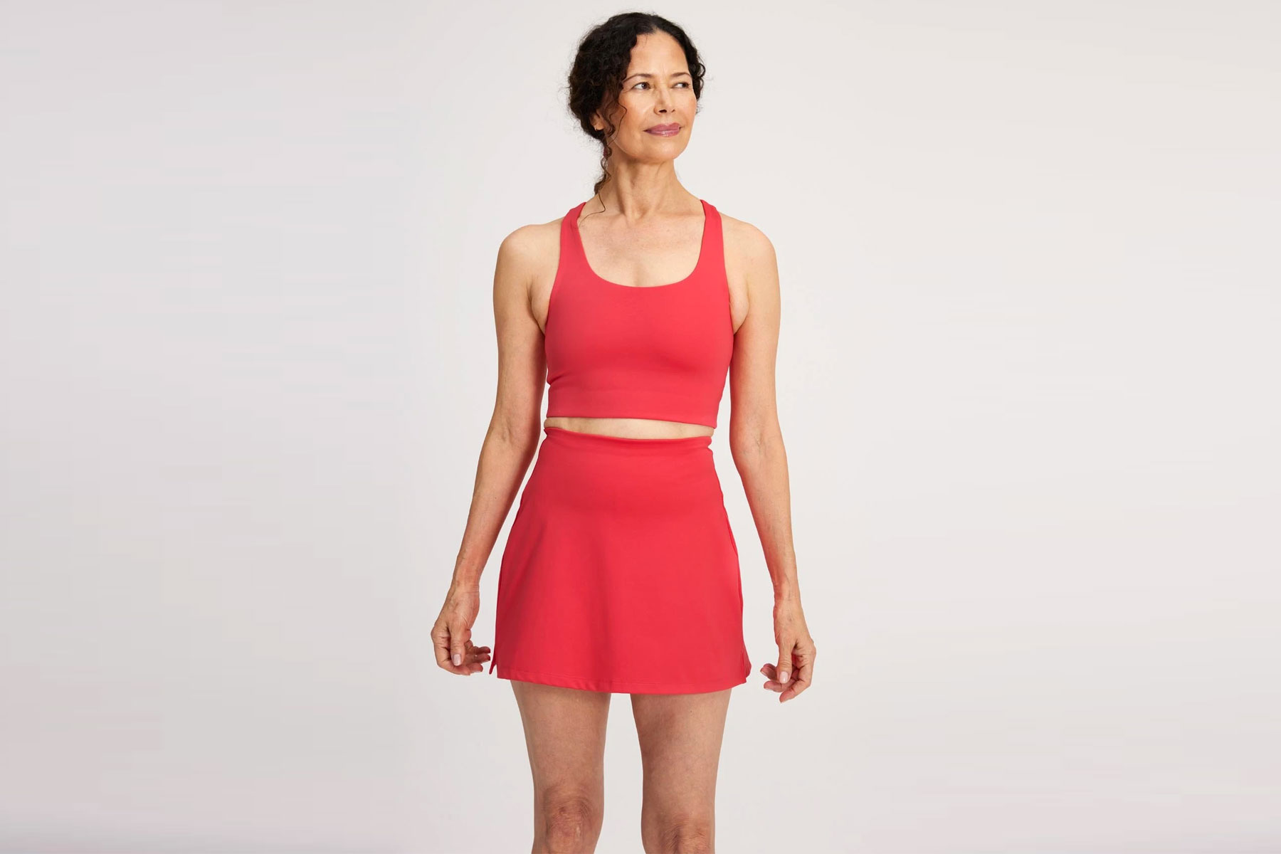 Woman wearing red sports bra and skort