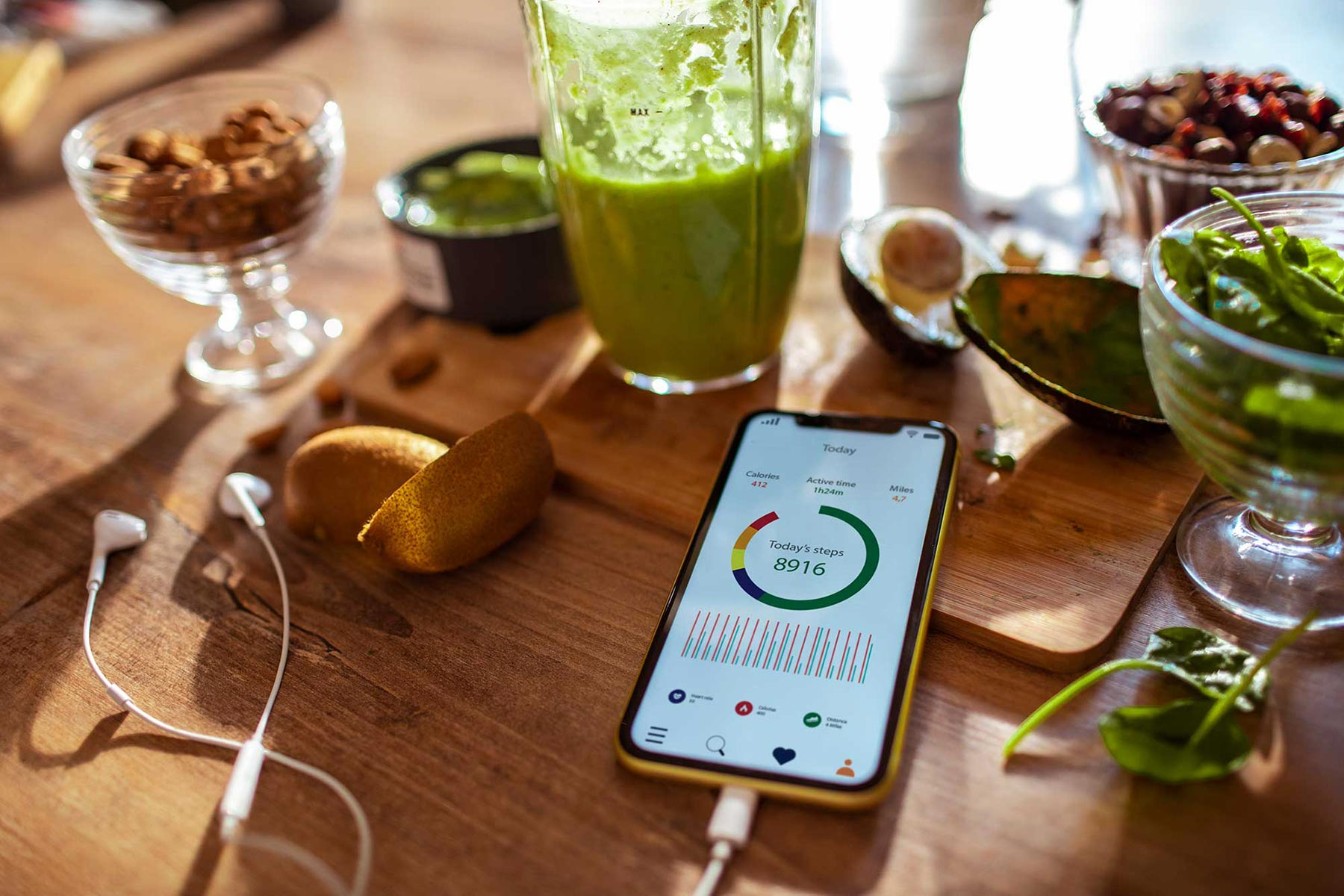 A mobile phone with a pedometer app and a healthy smoothie