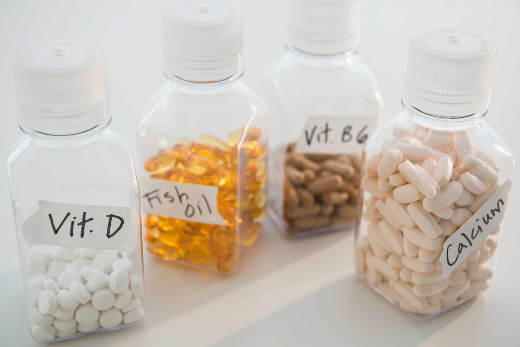 Various pills and vitamins in bottles