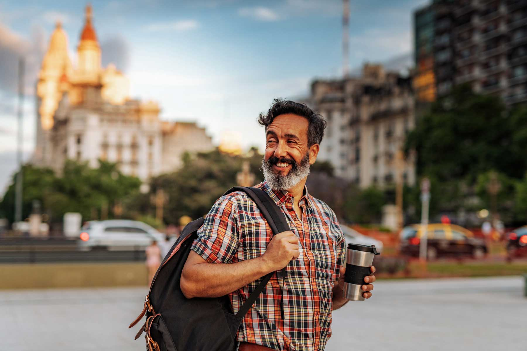 Mature Latino man with beard and stylish casual clothing in springtime day in Buenos Aires, Argentina.