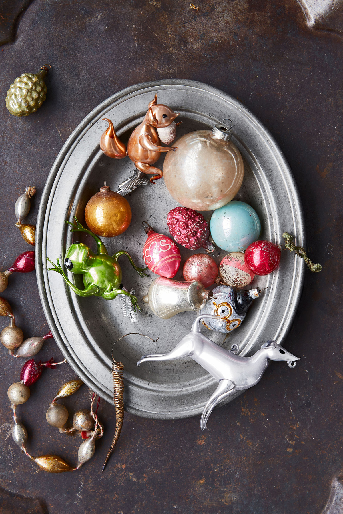 vintage christmas ornaments in silver platter