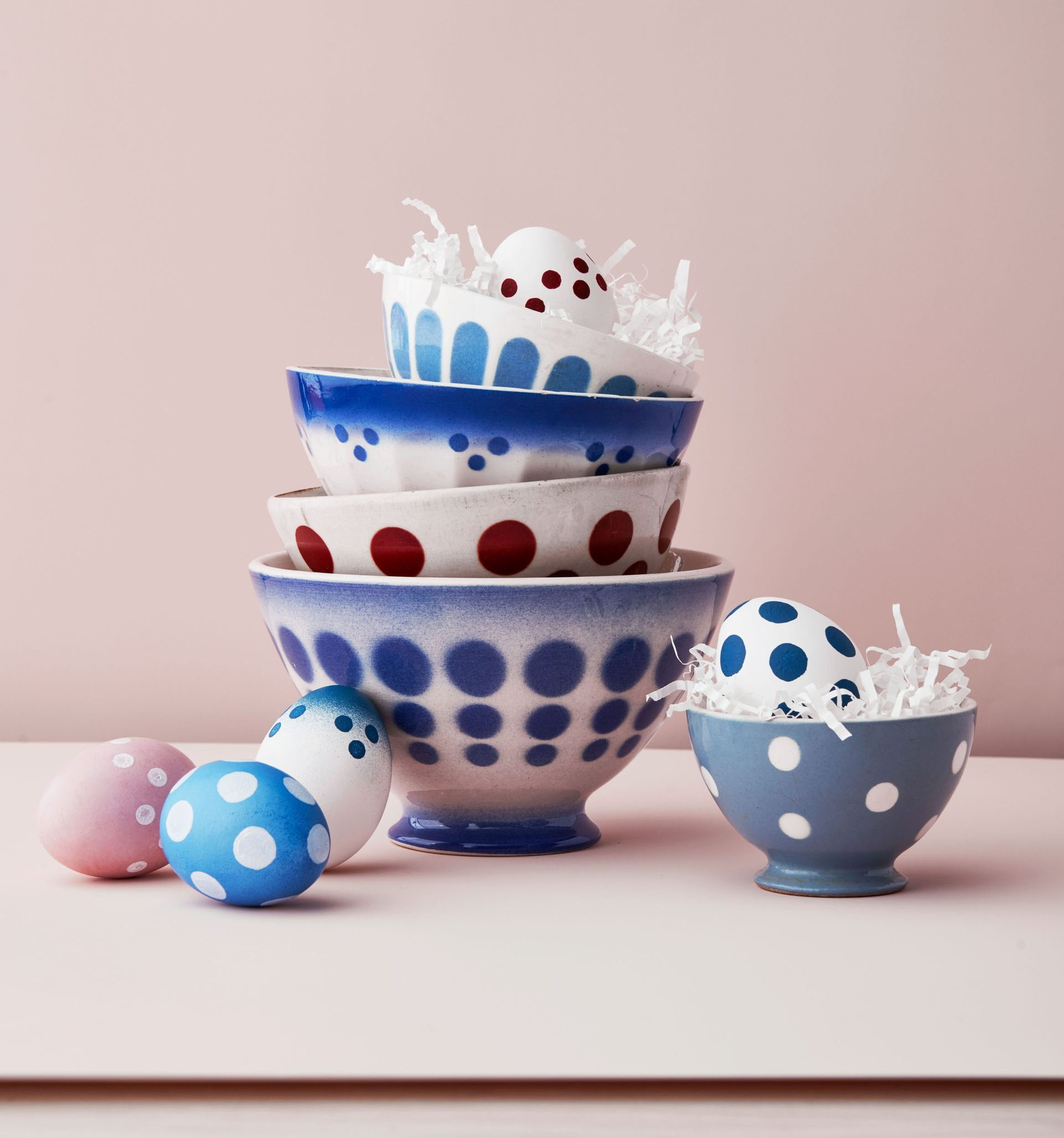 polka dot painted easter eggs in polka dot patterned bowls