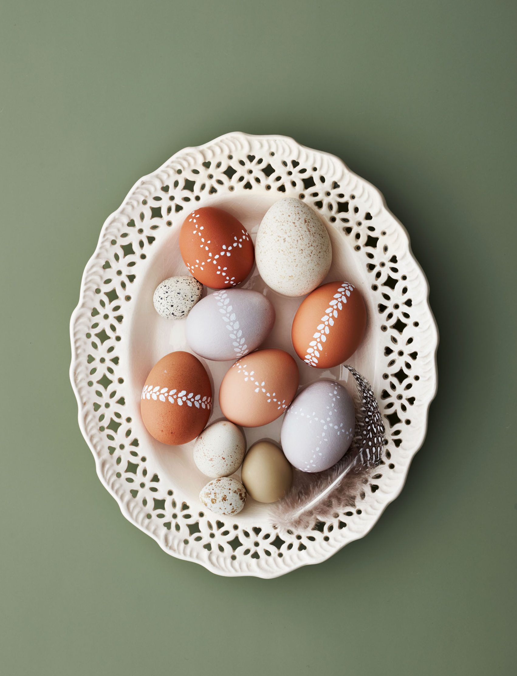 lace-painted easter eggs in an ivory dish