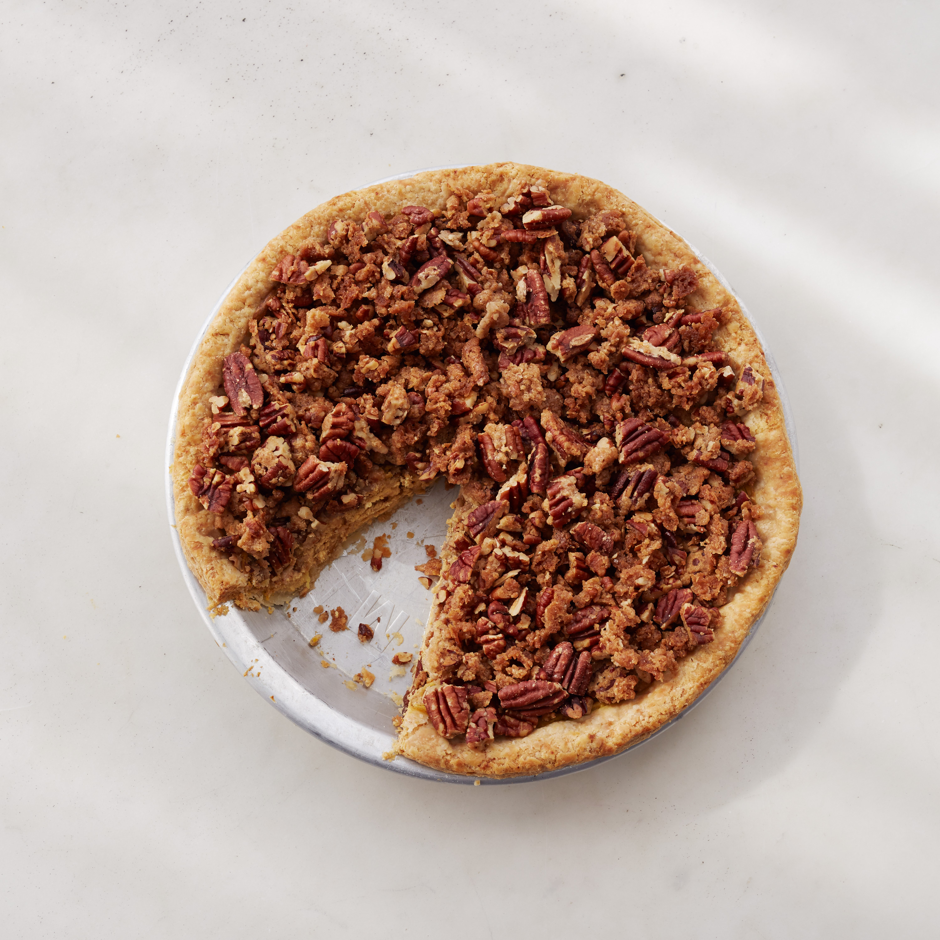 Add a pecan crumble topping for a new twist on traditional pumpkin pie this Thanksgiving.