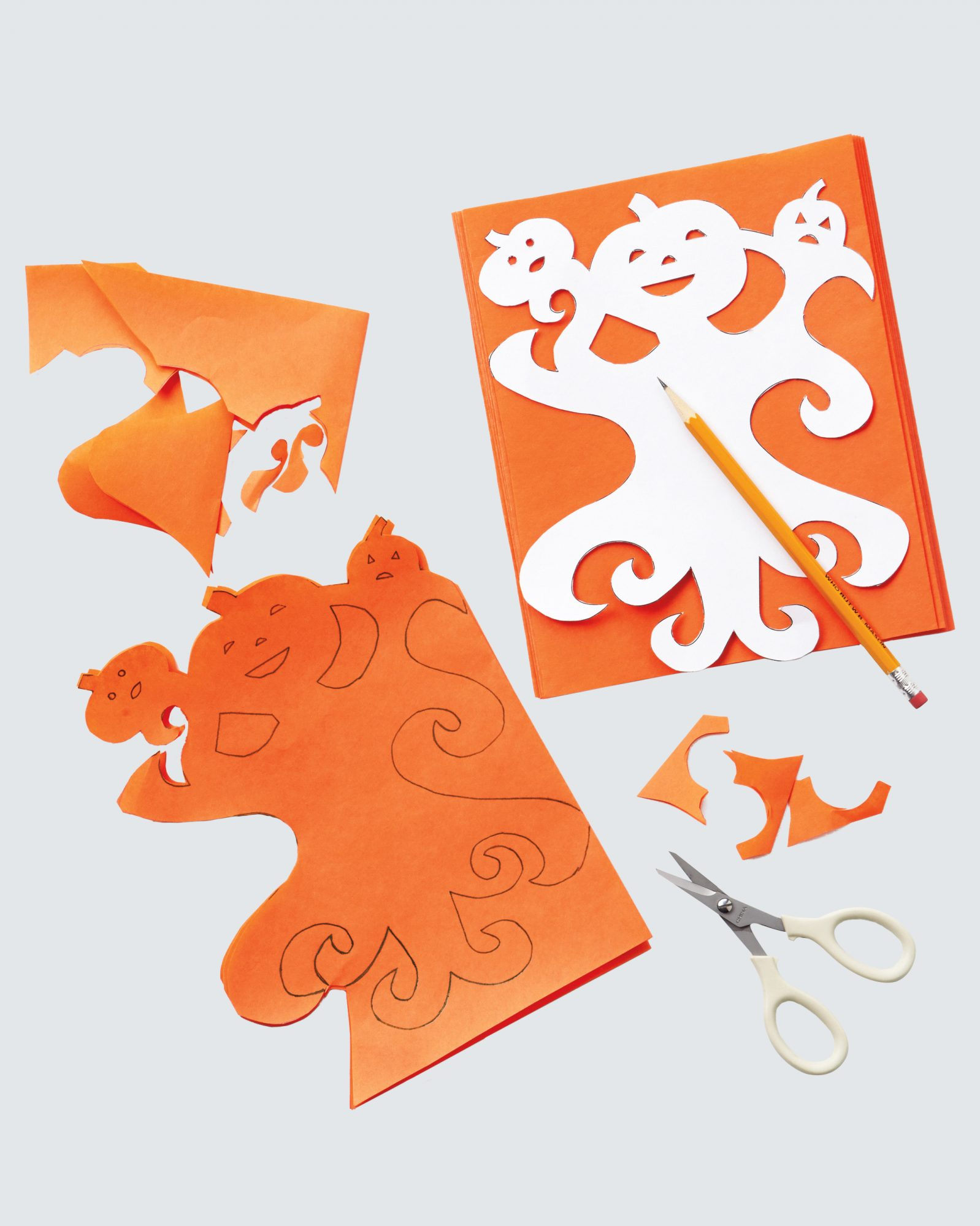 halloween paper doll cut out of orange paper
