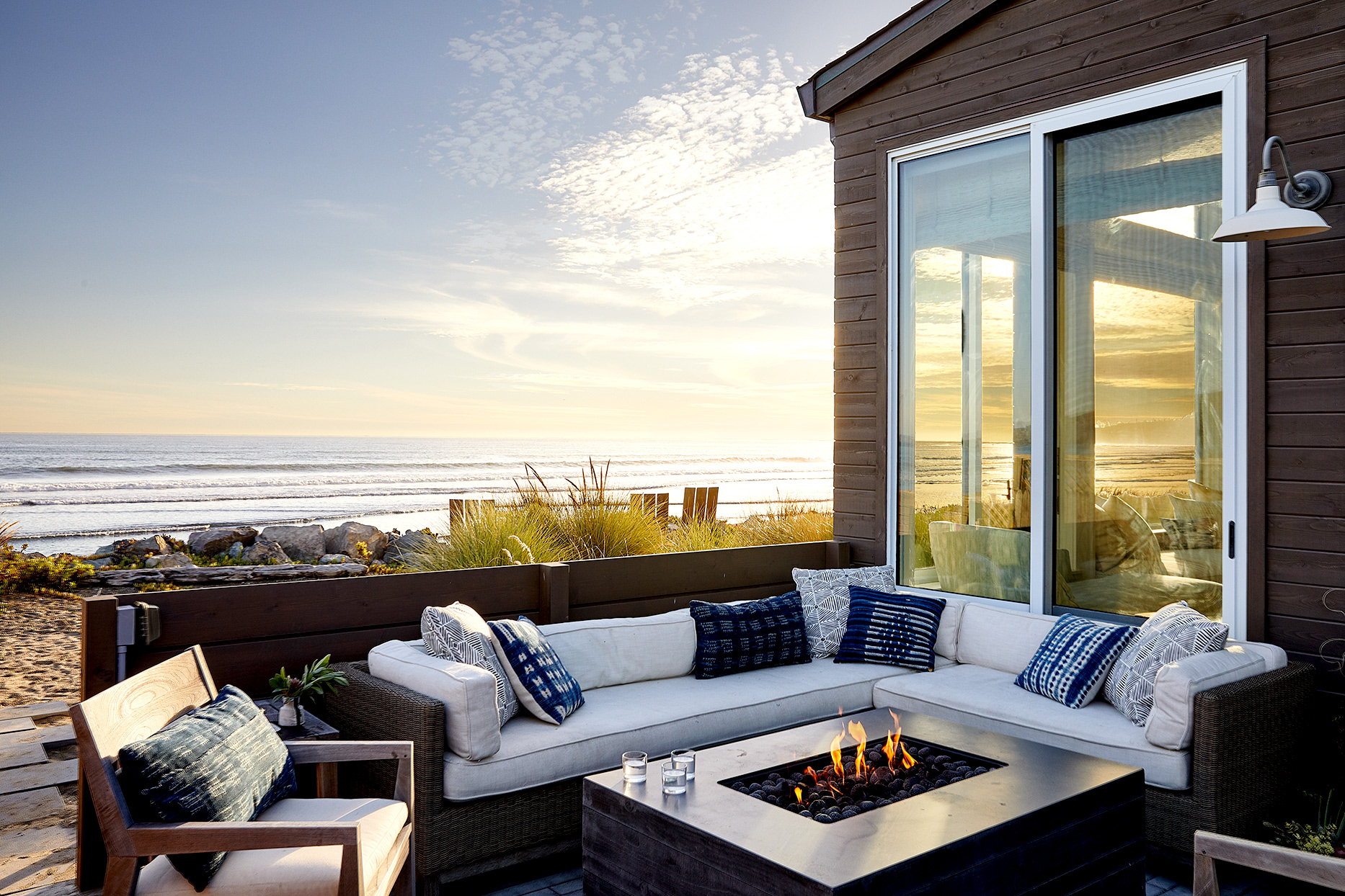 Porch with couch seating and bonfire pit