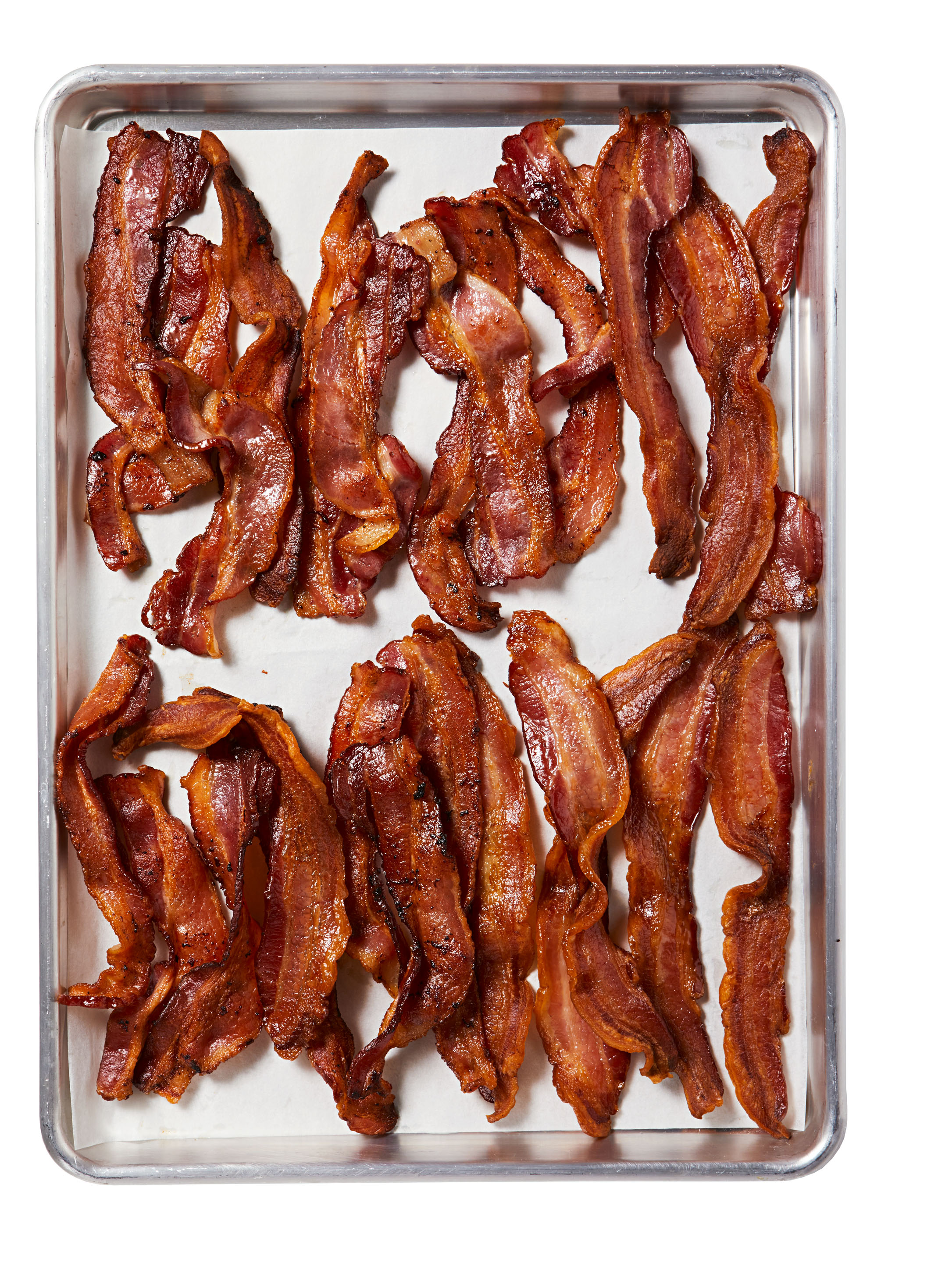 bacon on parchment paper-lined baking sheet