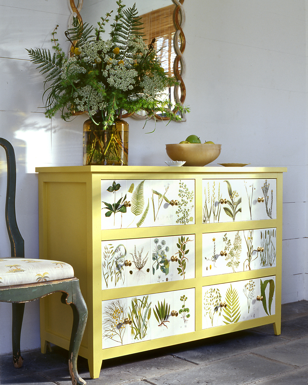 yellow dresser with botanical pressings
