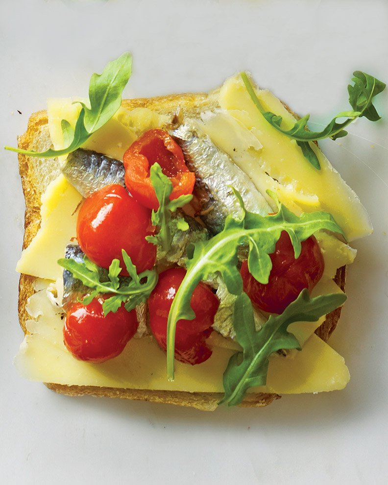 Gruyere, Oil-Packed Sardines, Peppadew Peppers, and Arugula on Rye