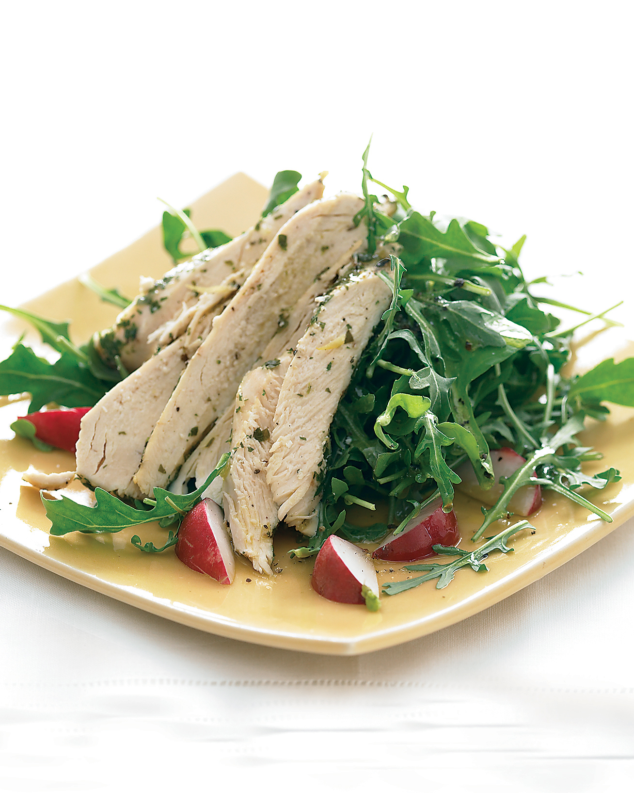 Chicken with Lemon and Wine over Arugula