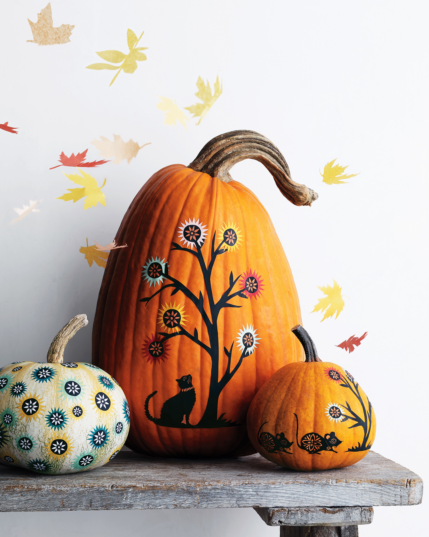 decorated orange pumpkin trio