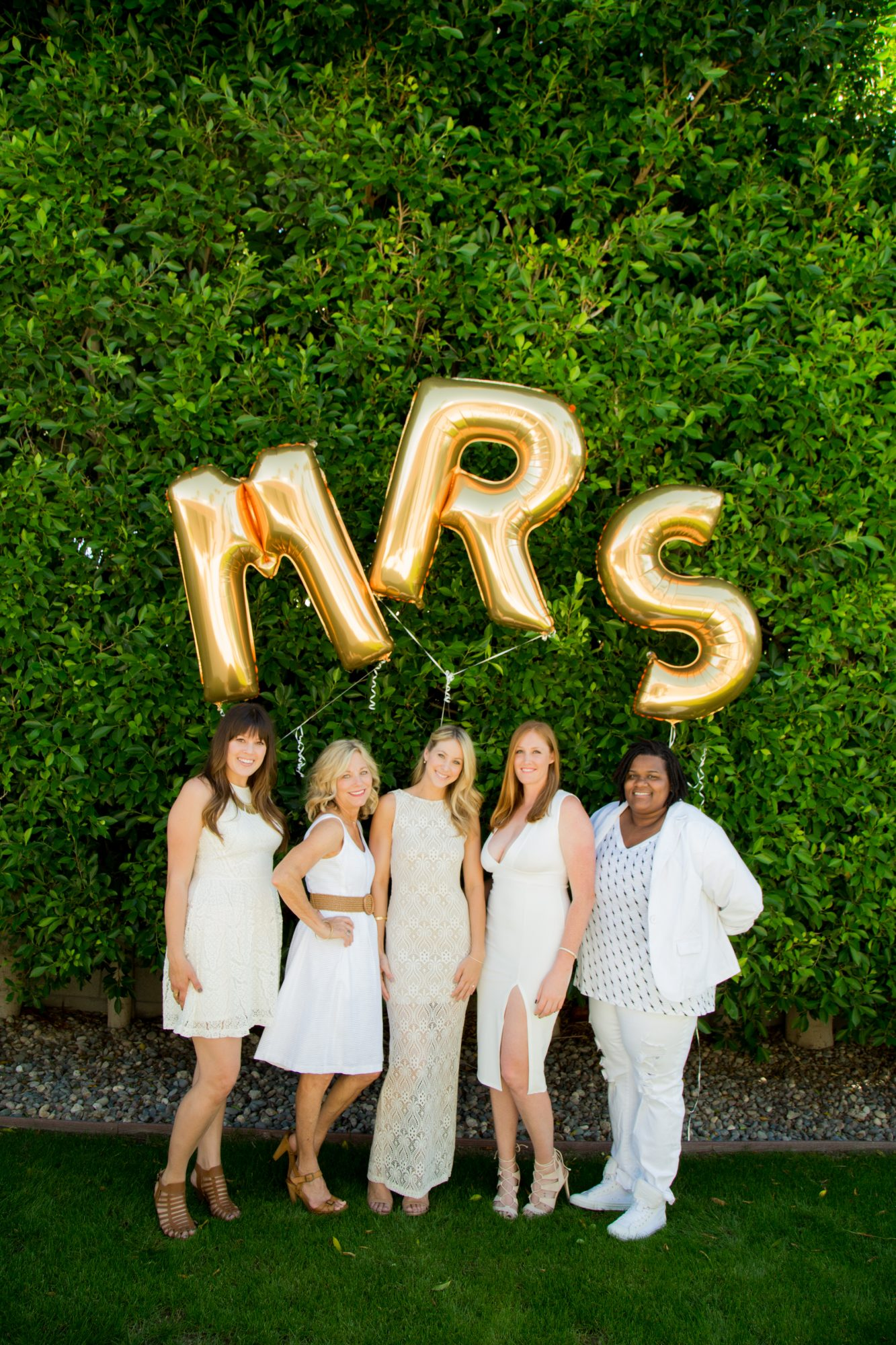 bridal shower guests with mrs balloons