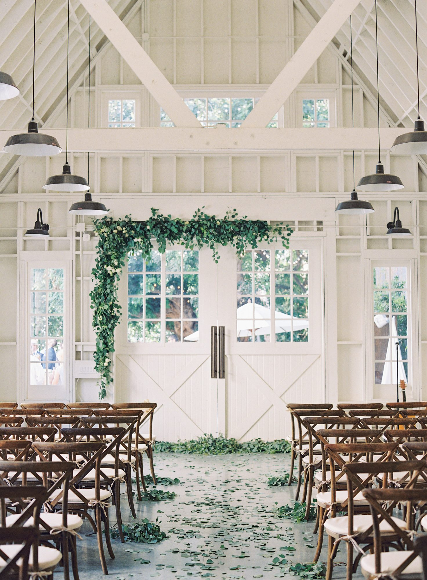 ceremony aisle with greenery and leaves
