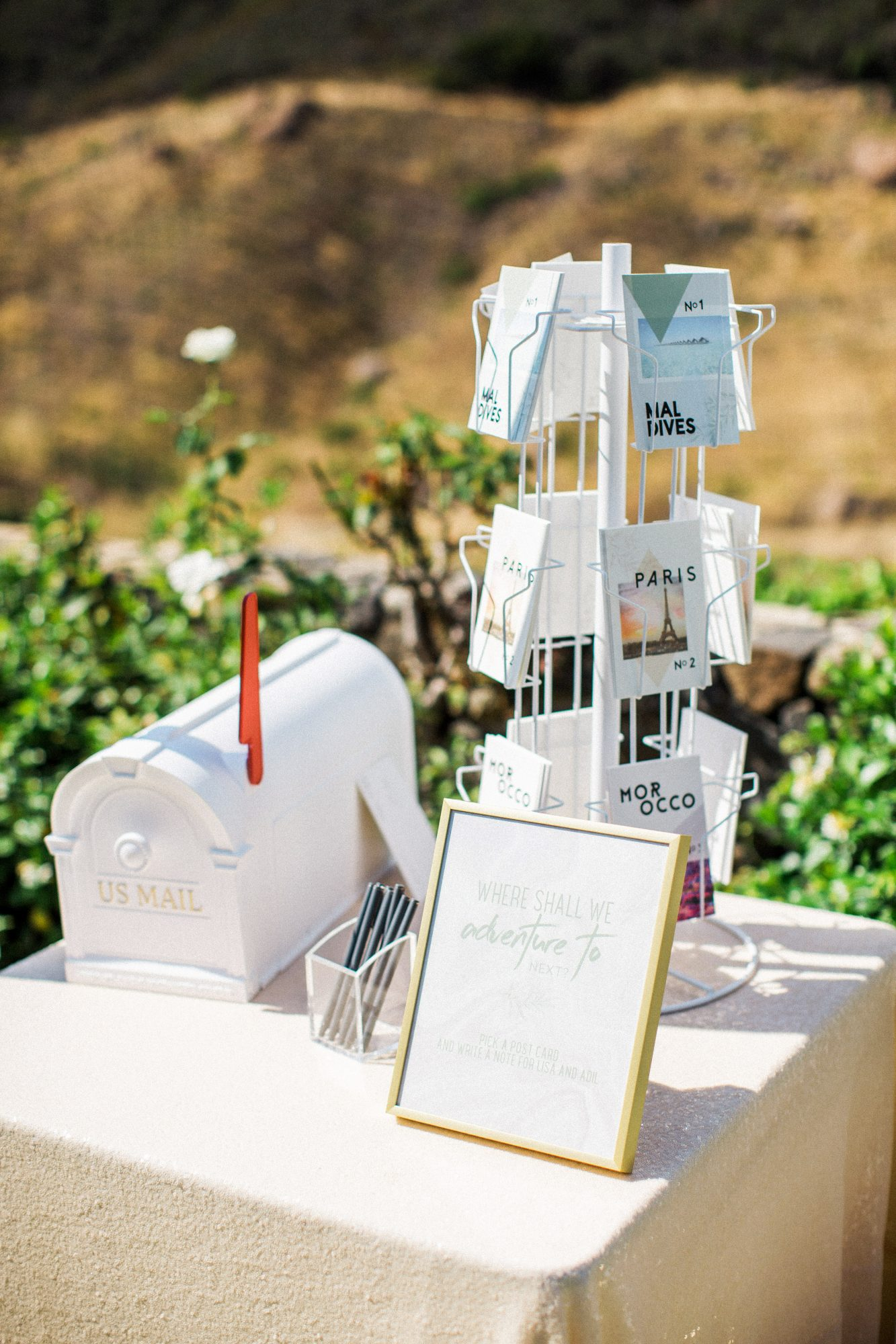 guest book post cards mailbox table