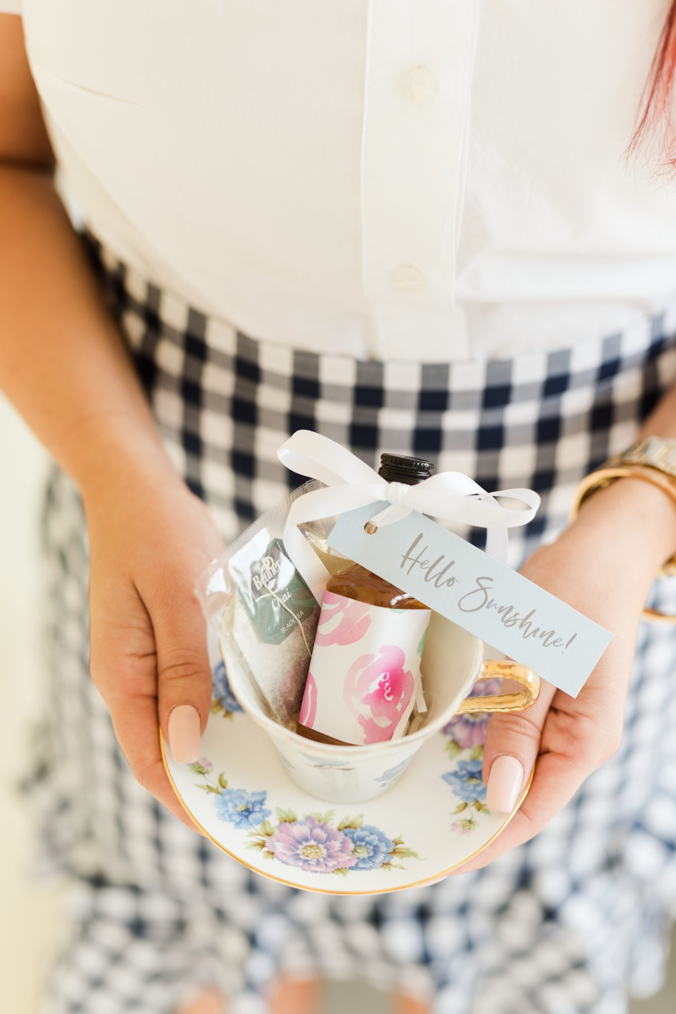 bride holding teacup filled with whiskey