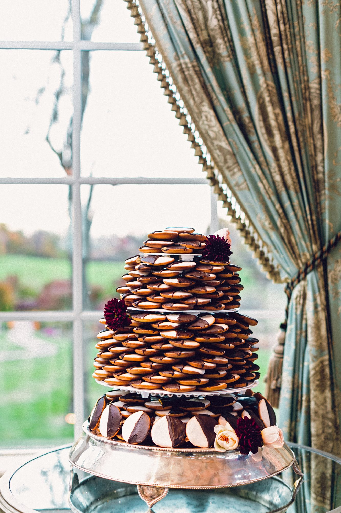 Love vanilla and chocolate equally, but don't feel like a traditional wedding cake fits your vibe as a couple? Take a hint from this smart duo, who arranged a tower of black-and-white cookies into a cake shape.