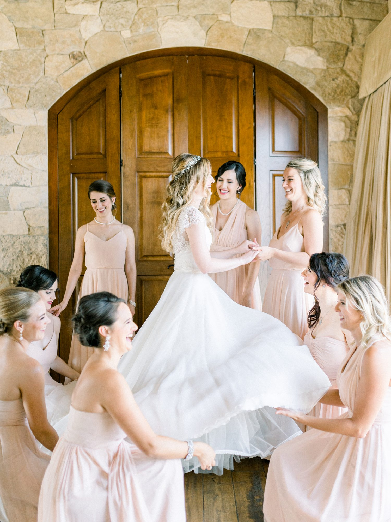 bridal party helping bride get dressed