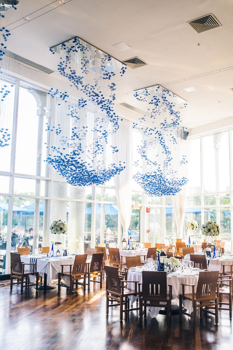 wedding reception space with modern chandeliers