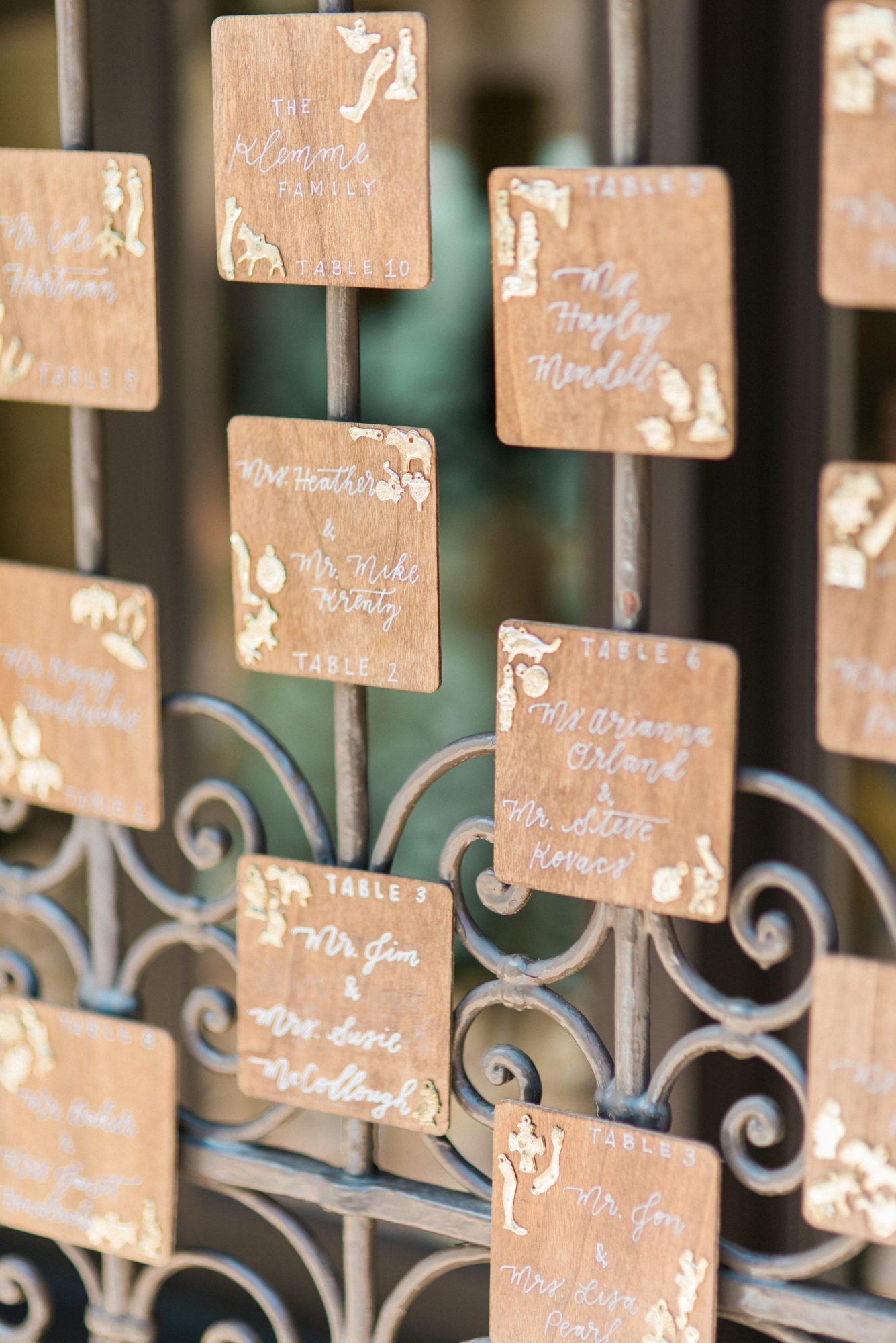 wooden seating card display on gate